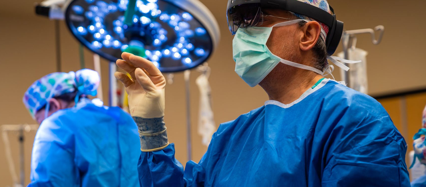 image of orthopedic surgeon Dr. John Sledge using HoloLens 2 headset during a spinal fusion surgery