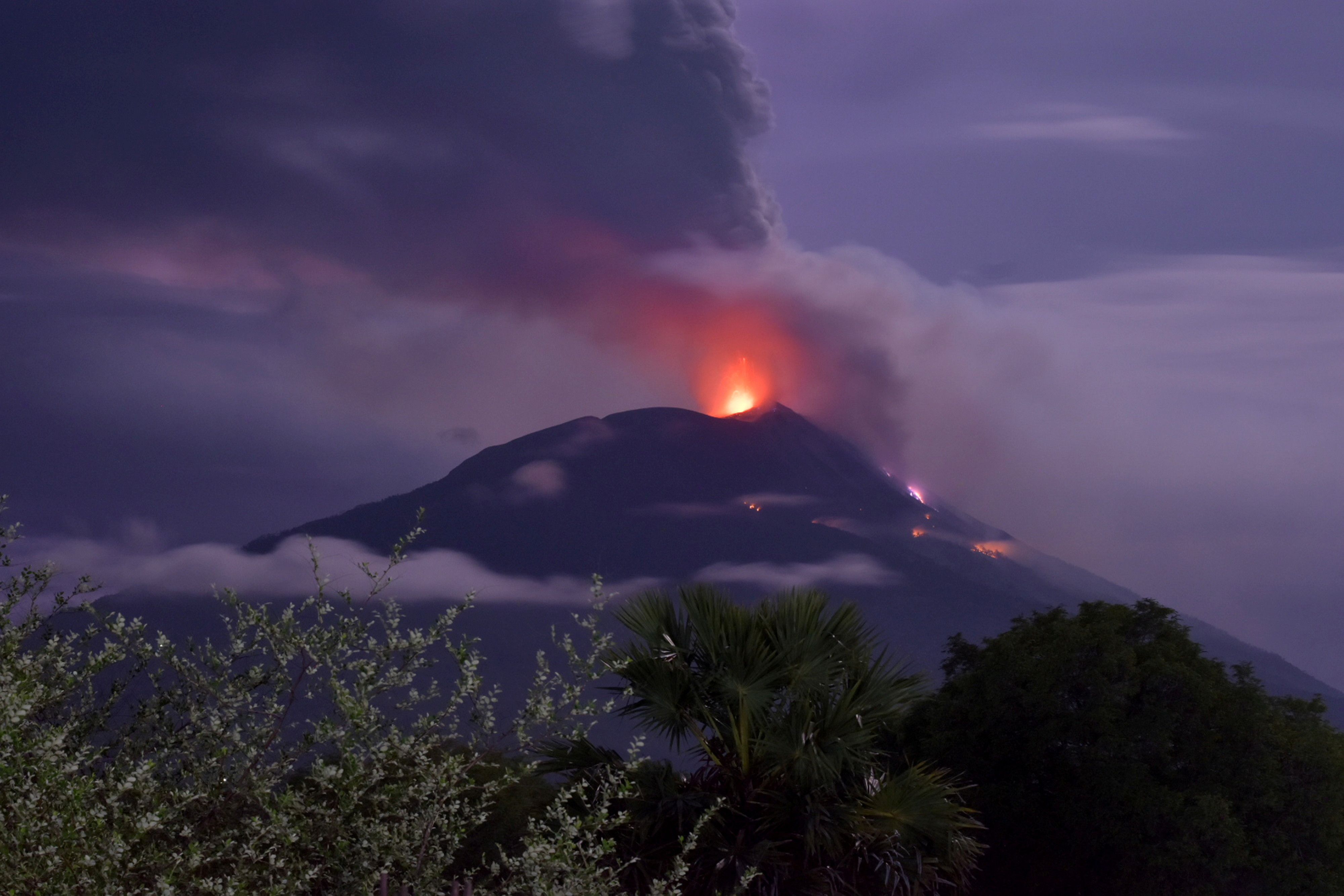 An eruption of Mount Ile Lewotolok is seen in Lembata, East Nusa Tenggara Province, Indonesia November 29, 2020. in this photo taken by Antara Foto/Aken Udjan via Reuters. ATTENTION EDITORS - THIS IMAGE WAS PROVIDED BY THIRD PARTY. MANDATORY CREDIT. INDONESIA OUT. - RC22DK94XIXC