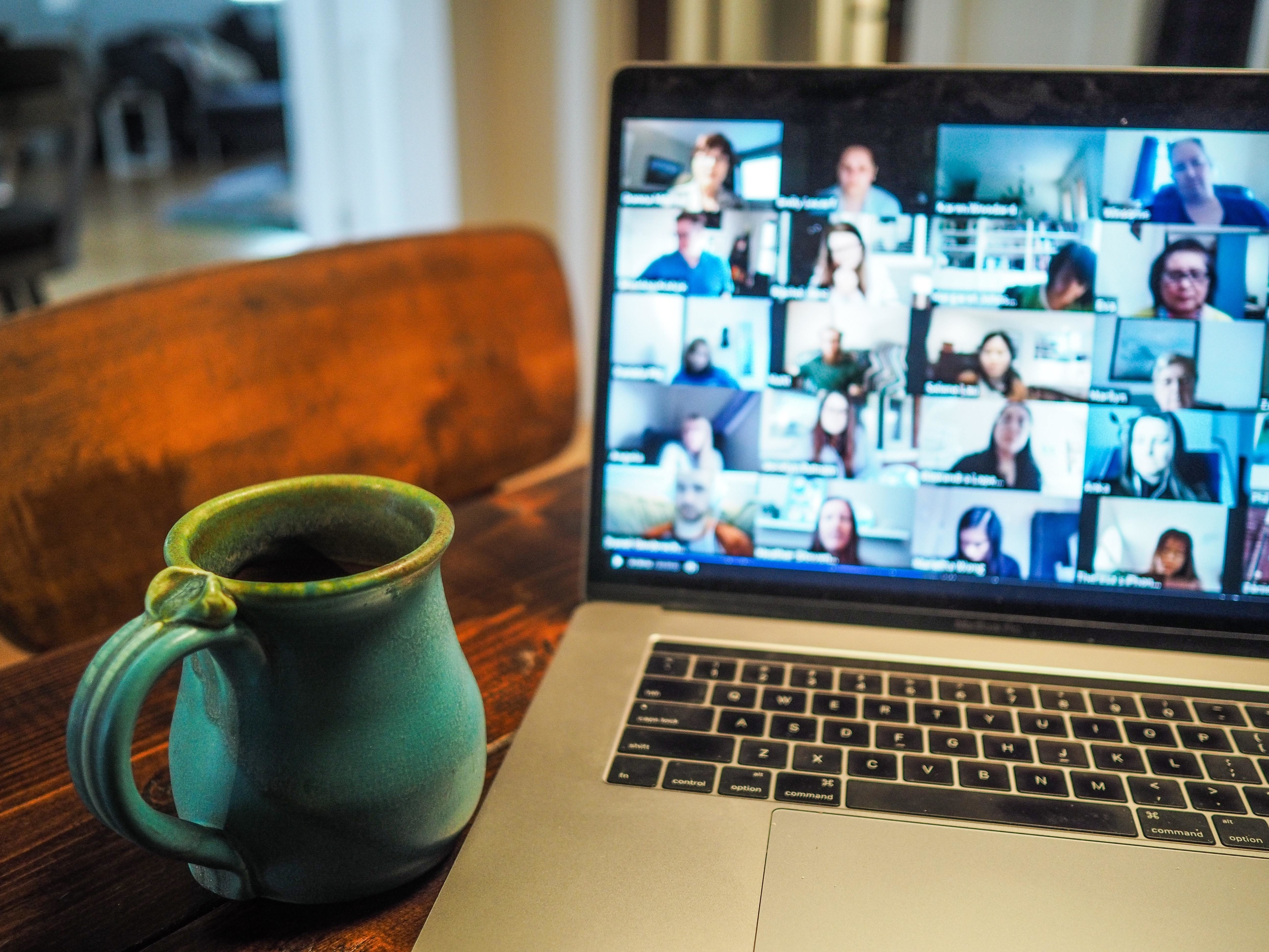 A video conference on a laptop.