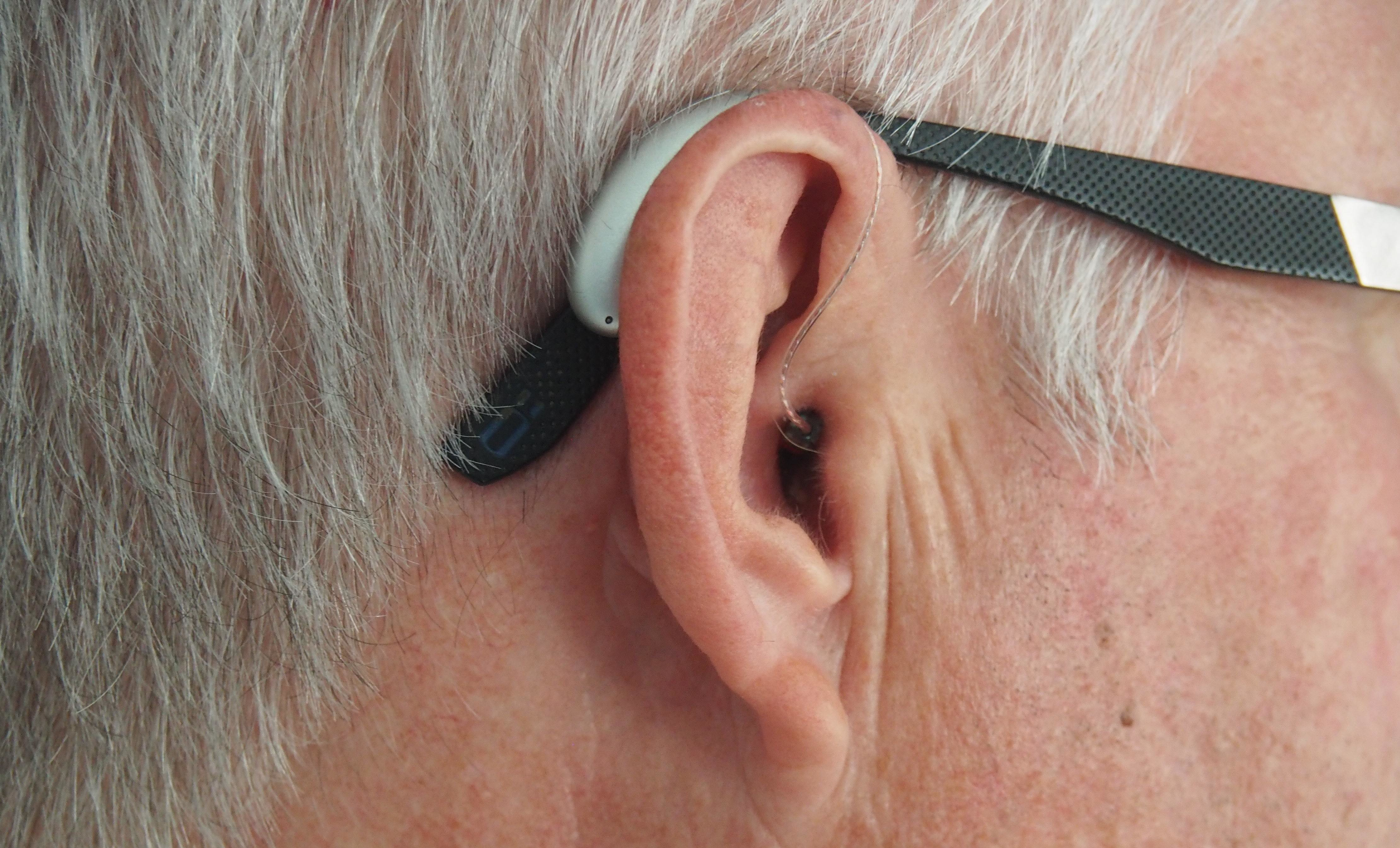 a picture of a hearing aid in a man's ear