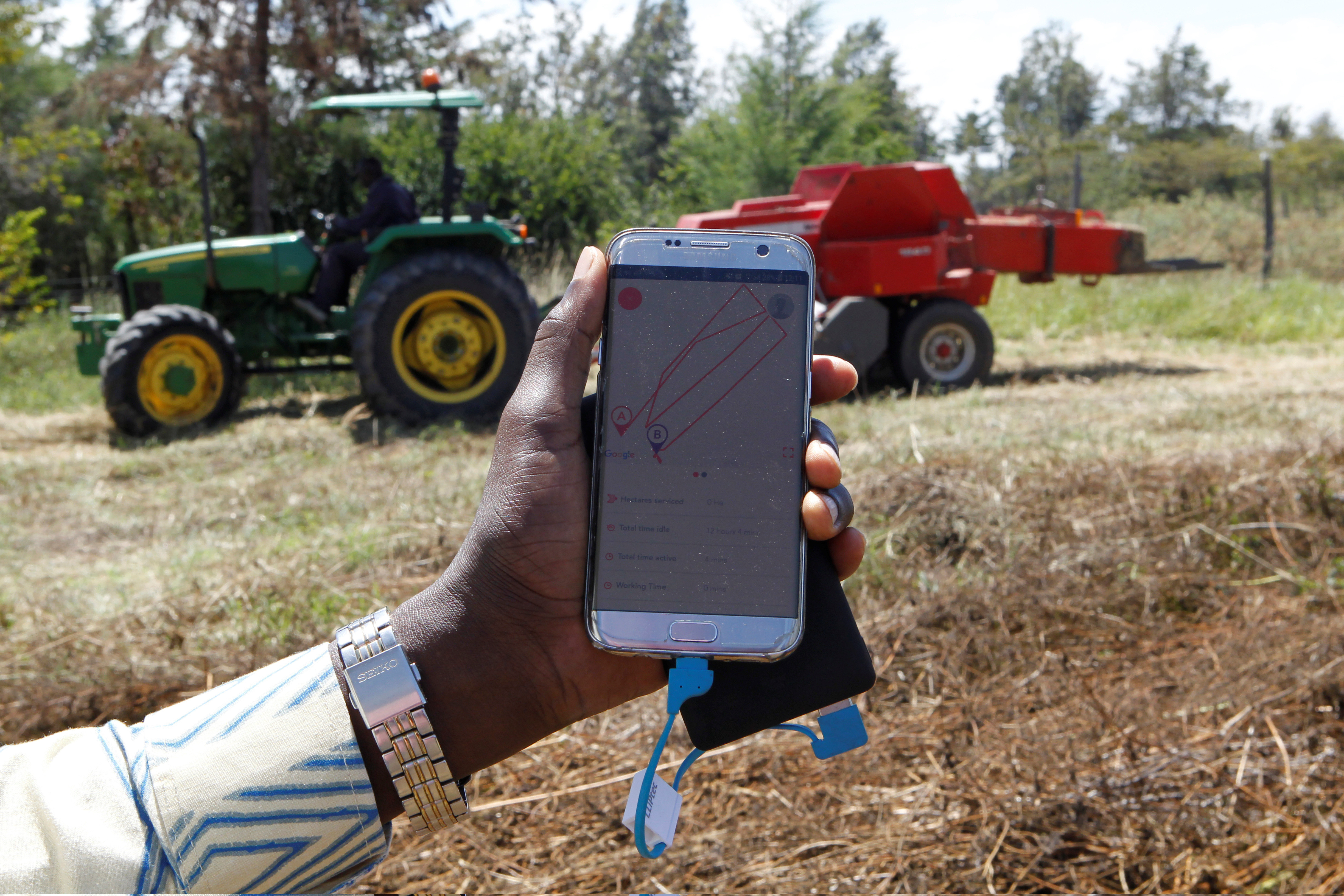 A mobile phone application shows movements of a John Deere 5503 tractor, installed with the Hello Tractor technology that connects farmers with vehicles' owners, in Umande village in Nanyuki, Kenya February 4, 2020. Picture taken February 4, 2020. REUTERS/Njeri Mwangi - RC2F7F9WHWYX