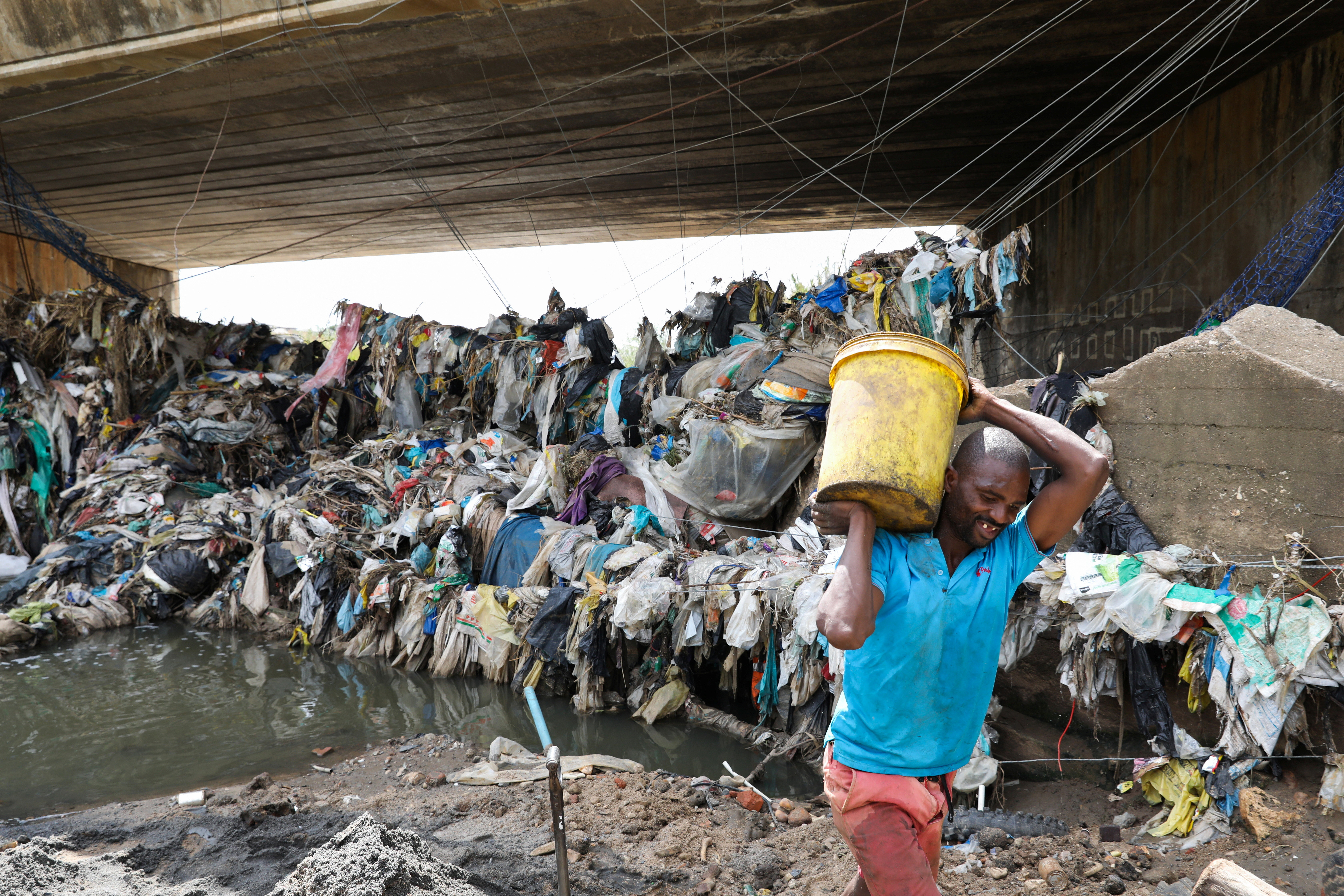 A man collects recyclable plastic in Olifantsfontein near Kempton Park, South Africa