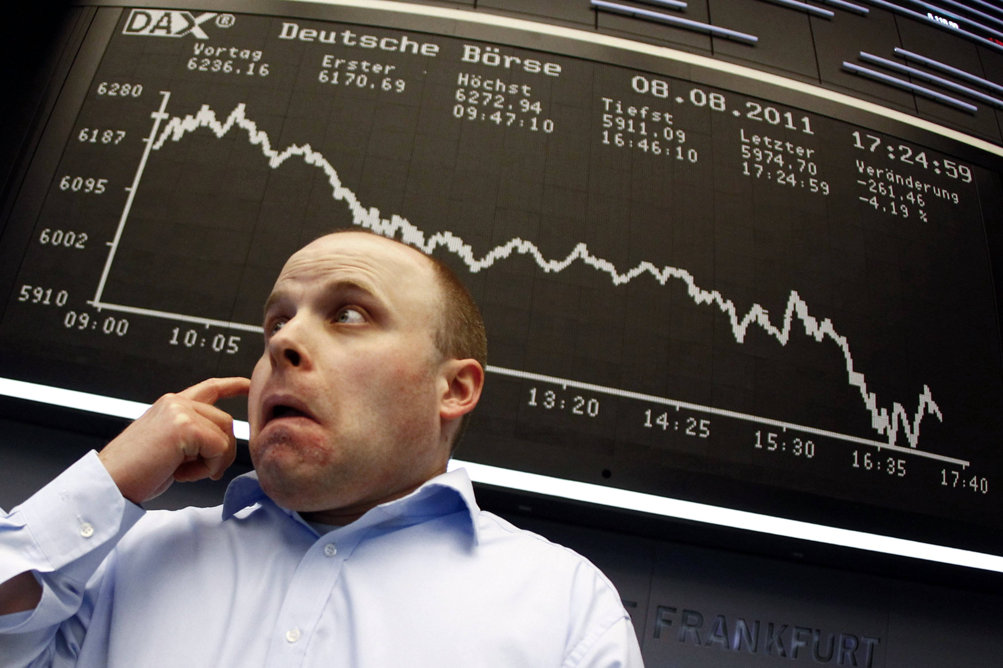 a stock trader reacts to a fall in the markets