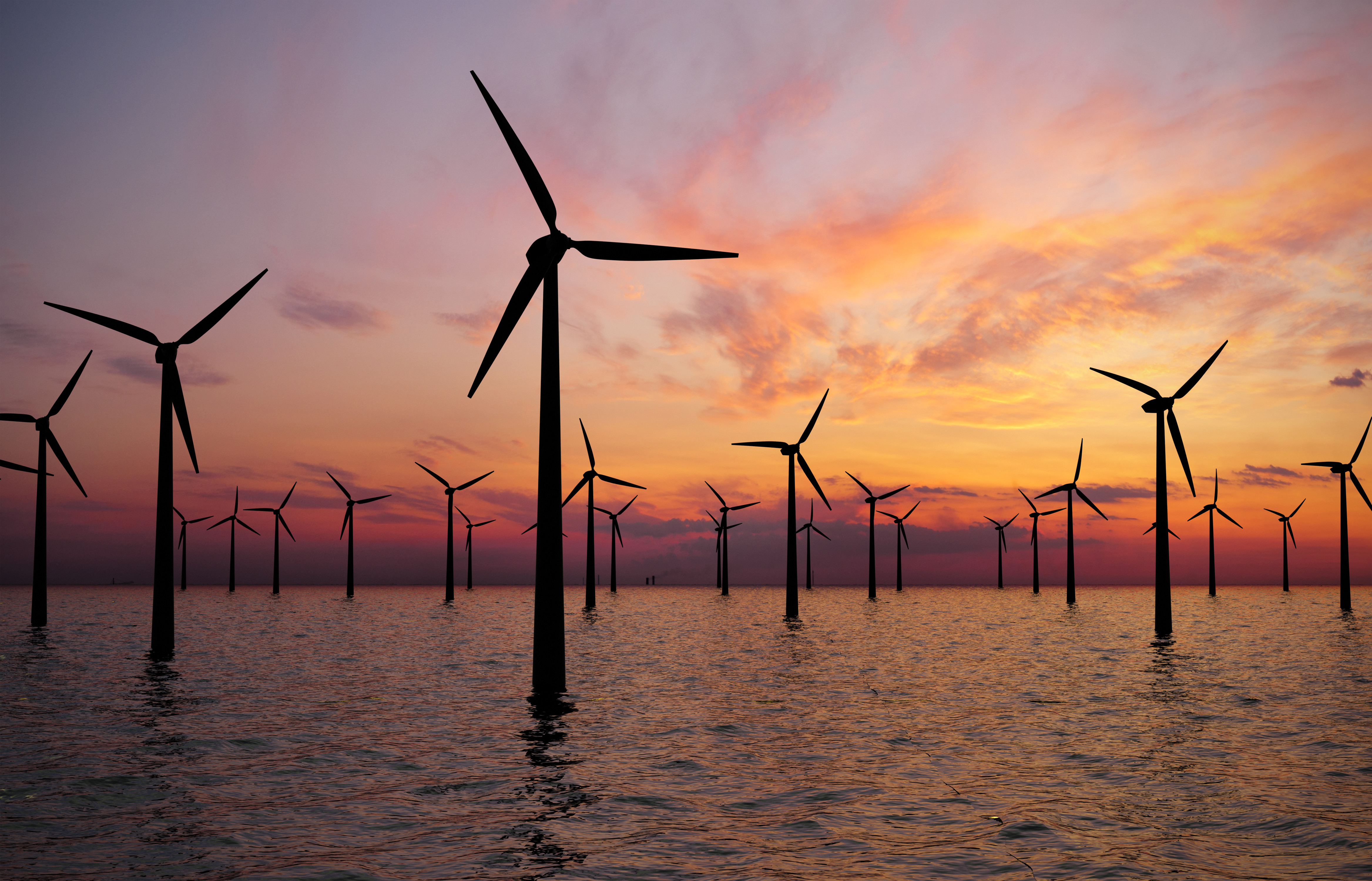 Offshore Wind Turbines Farm At sunset