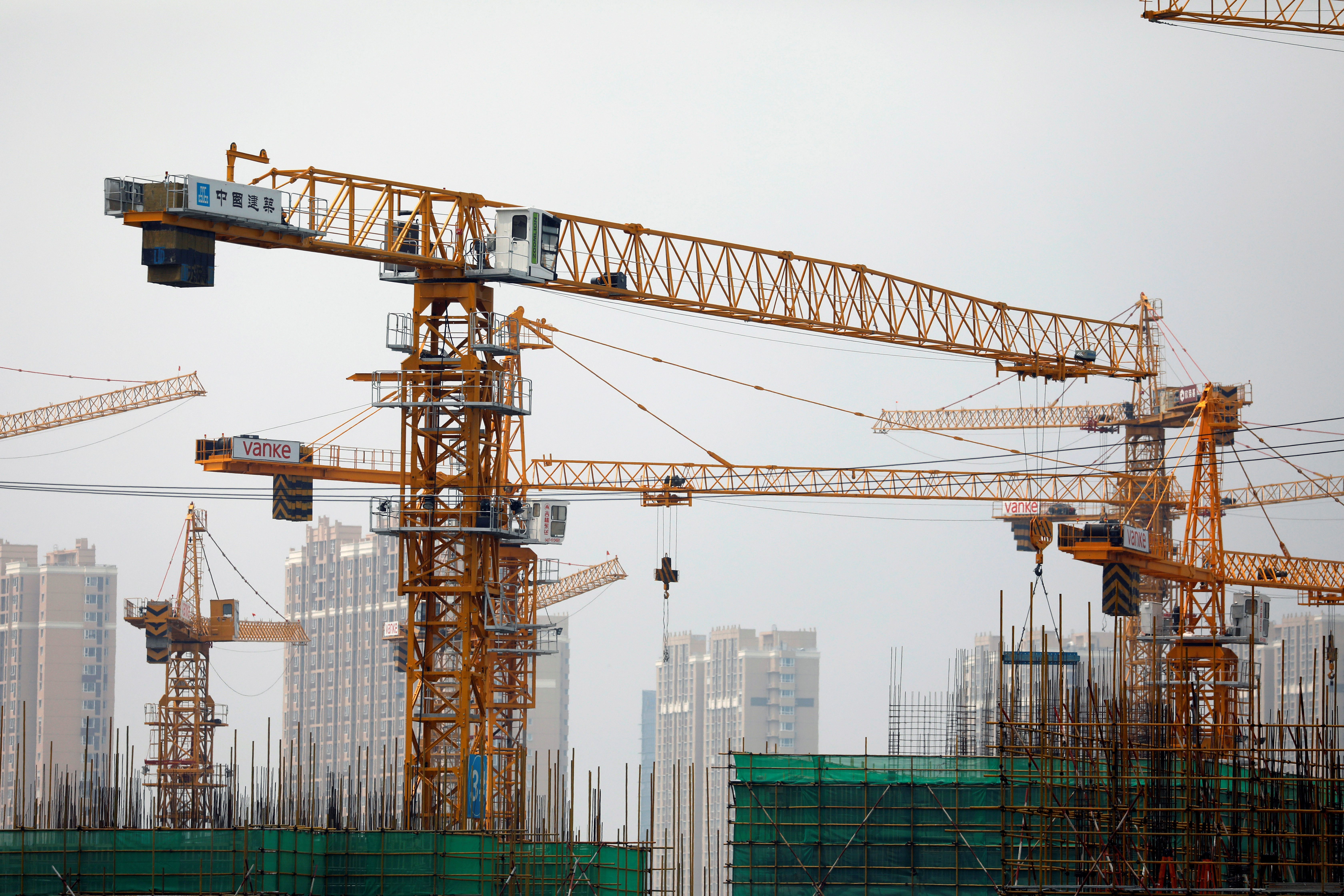 Cranes are seen at a construction site in Beijing, China July 16, 2020.