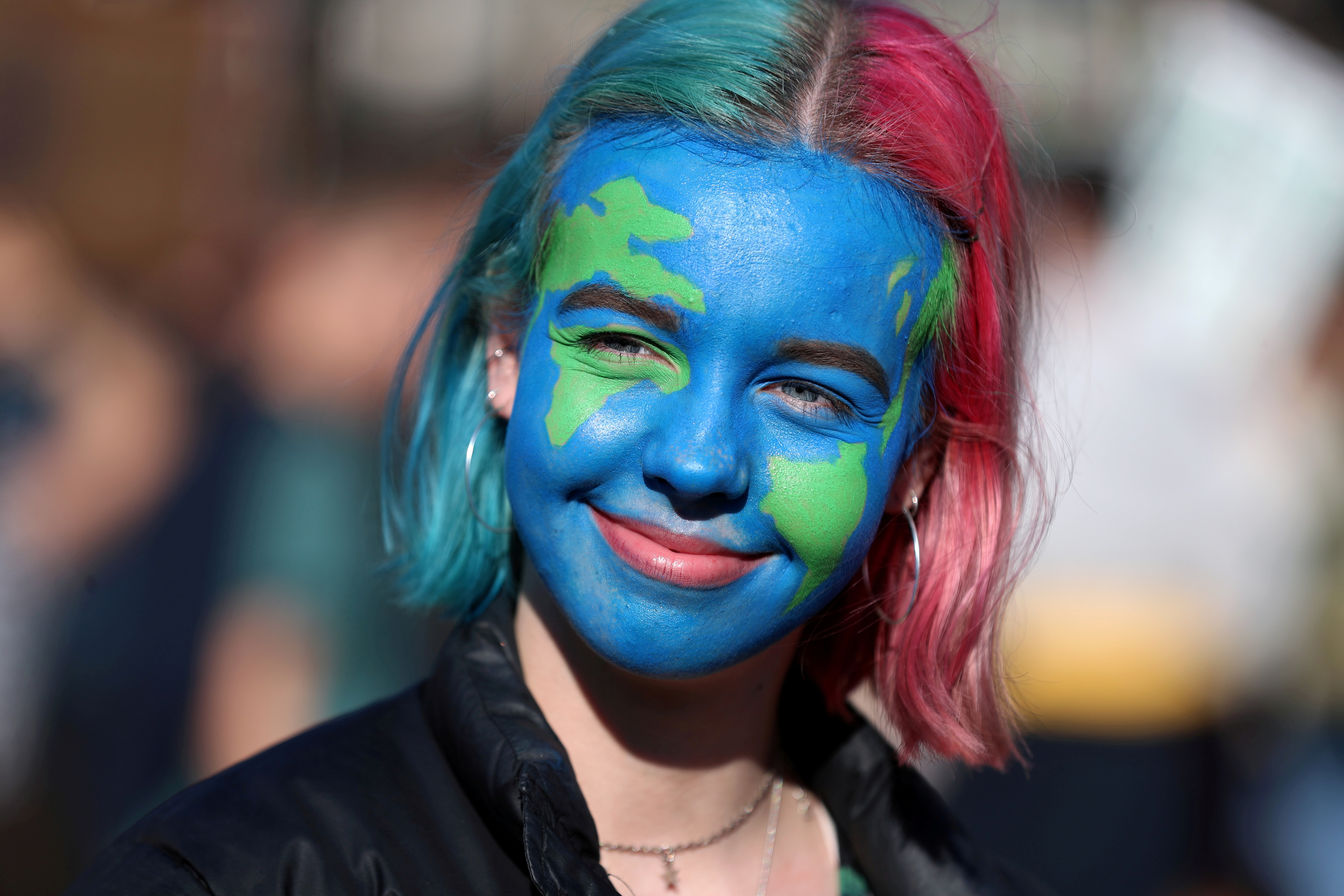 """A girl looks on as people take part in a """"youth strike for climate change"""" demonstration in London, Britain February 15, 2019. REUTERS/Simon Dawson     TPX IMAGES OF THE DAY - RC18EDC3F400"""