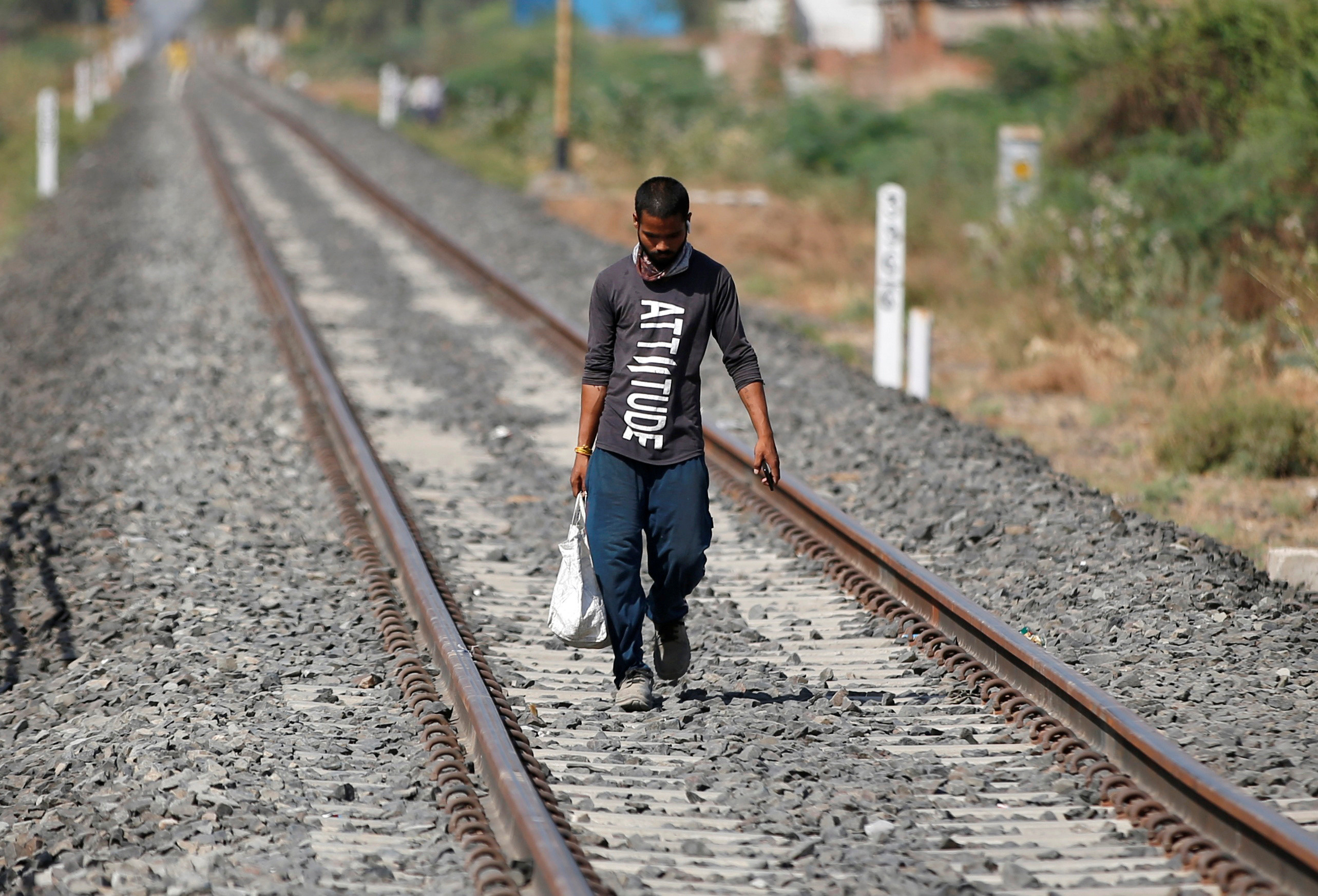 A migrant worker walks along a railway track to return to his home state of central Madhya Pradesh, during an extended nationwide lockdown to slow the spreading of the coronavirus disease (COVID-19), in Ahmedabad, India, May 19, 2020