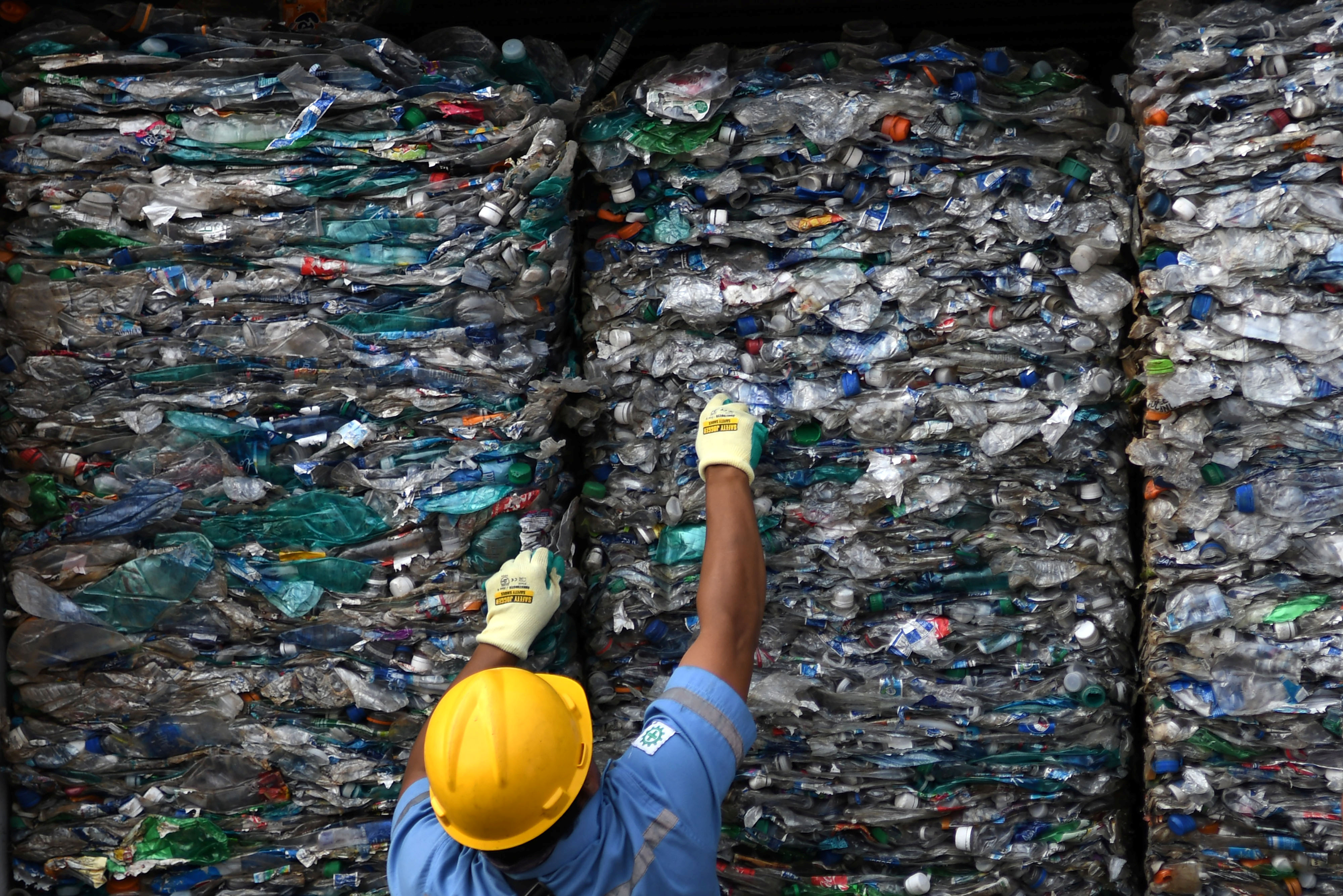 An officer shows a container full with plastic waste at Tanjung Priok port in Jakarta, Indonesia, September 18, 2019.