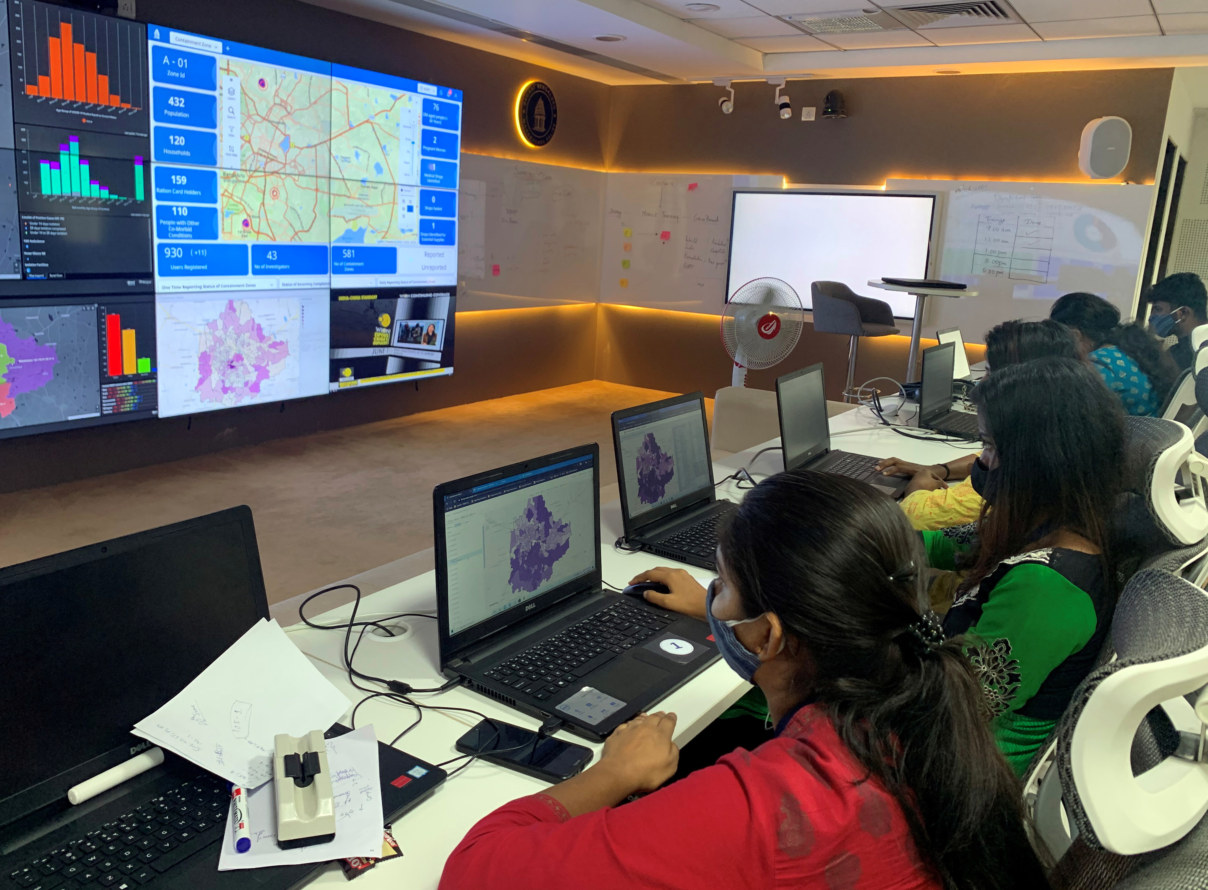 """Software professionals assisting municipal authorities work on their terminals inside a """"war room"""" focused on tracking the spread of the coronavirus disease (COVID-19) at the Bruhat Bengaluru Mahanagara Palike office in Bengaluru, India July 2, 2020. Picture taken July 2, 2020. REUTERS/Nivedita Bhattacharjee - RC2CLI9W531O"""