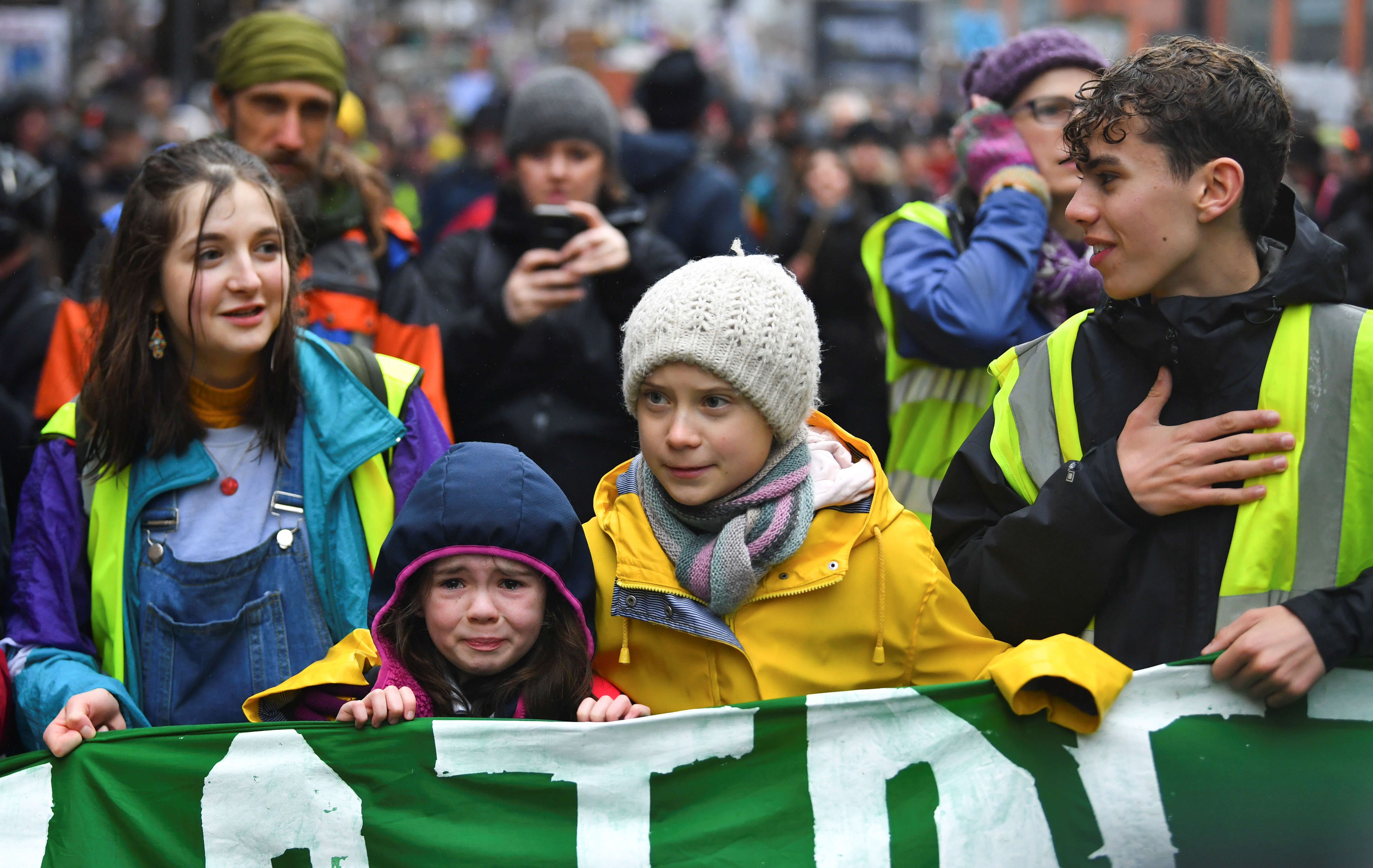 Swedish environmental activist Greta Thunberg embraces a crying girl on a youth climate protest in Bristol, UK.