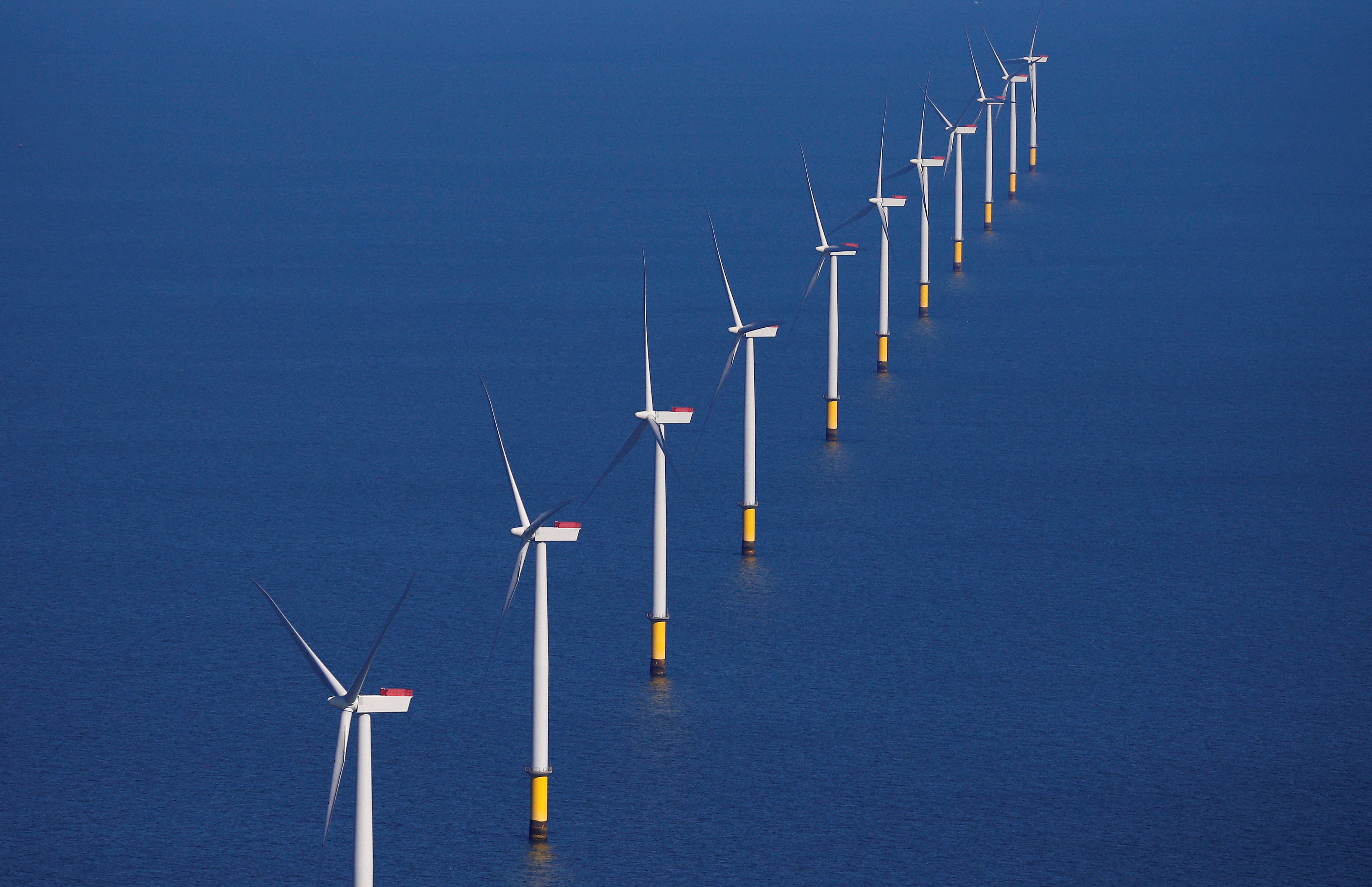 General view of the Walney Extension offshore wind farm operated by Orsted off the coast of Blackpool, Britain.