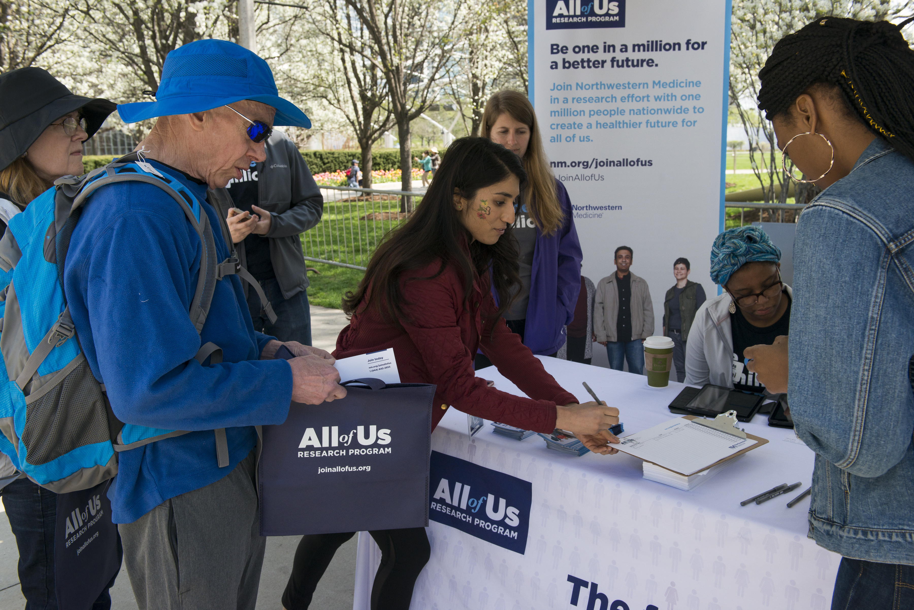 Community members come together to raise awareness about the All of Us Research Program.