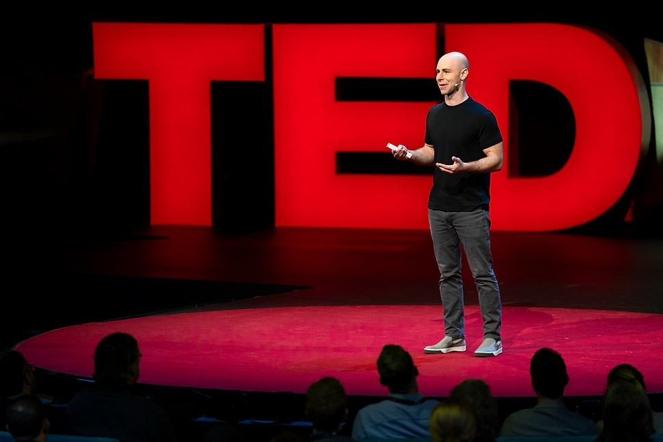 A photo of Adam Grant giving a TED talk