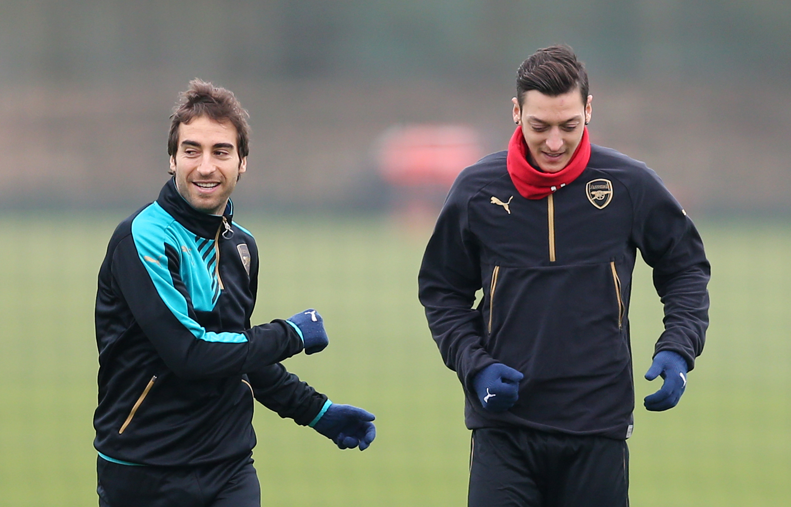 Football Soccer - Arsenal Training - Arsenal Training Ground - 15/3/16Arsenal's Mathieu Flamini and Mesut Ozil during trainingAction Images via Reuters / Matthew ChildsLivepicEDITORIAL USE ONLY. - 14312997