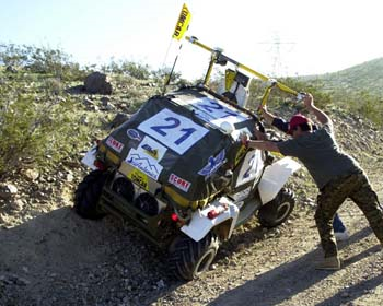 One of many robot cars to get into trouble at the DARPA Grand Challenge 2004