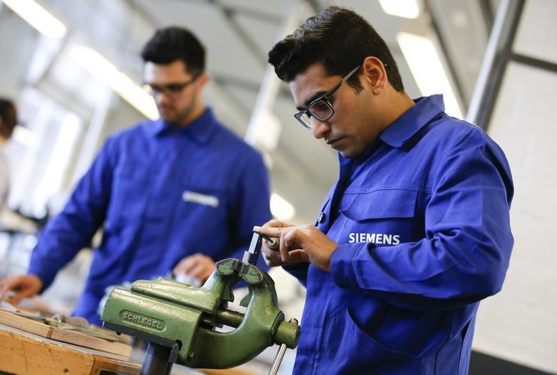 Refugees show their skills in metal processing works during a media tour at a workshop for refugees organized by German industrial group Siemens in Berlin, Germany, April 21, 2016. Germany?s blue-chip companies have managed to hire fewer than 100 refugees after close to a million arrived in the country last year. Merkel, fighting for her political life over her open-door policy, has summoned DAX bosses to Berlin to account for their lack of action and exchange ideas about how they can do better.