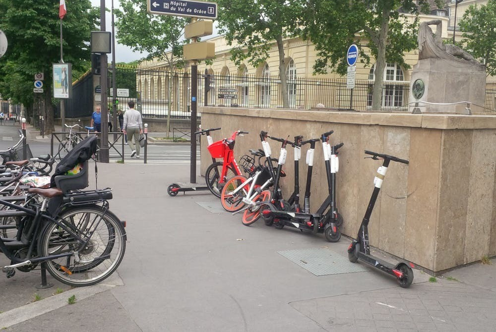 Paris, Rue de l'Abbé de l'Epée and the Boulevard Saint-Michel, May 27, 2019. Eight Birds, one Jump and a Mobike try to temp city residents and visitors.