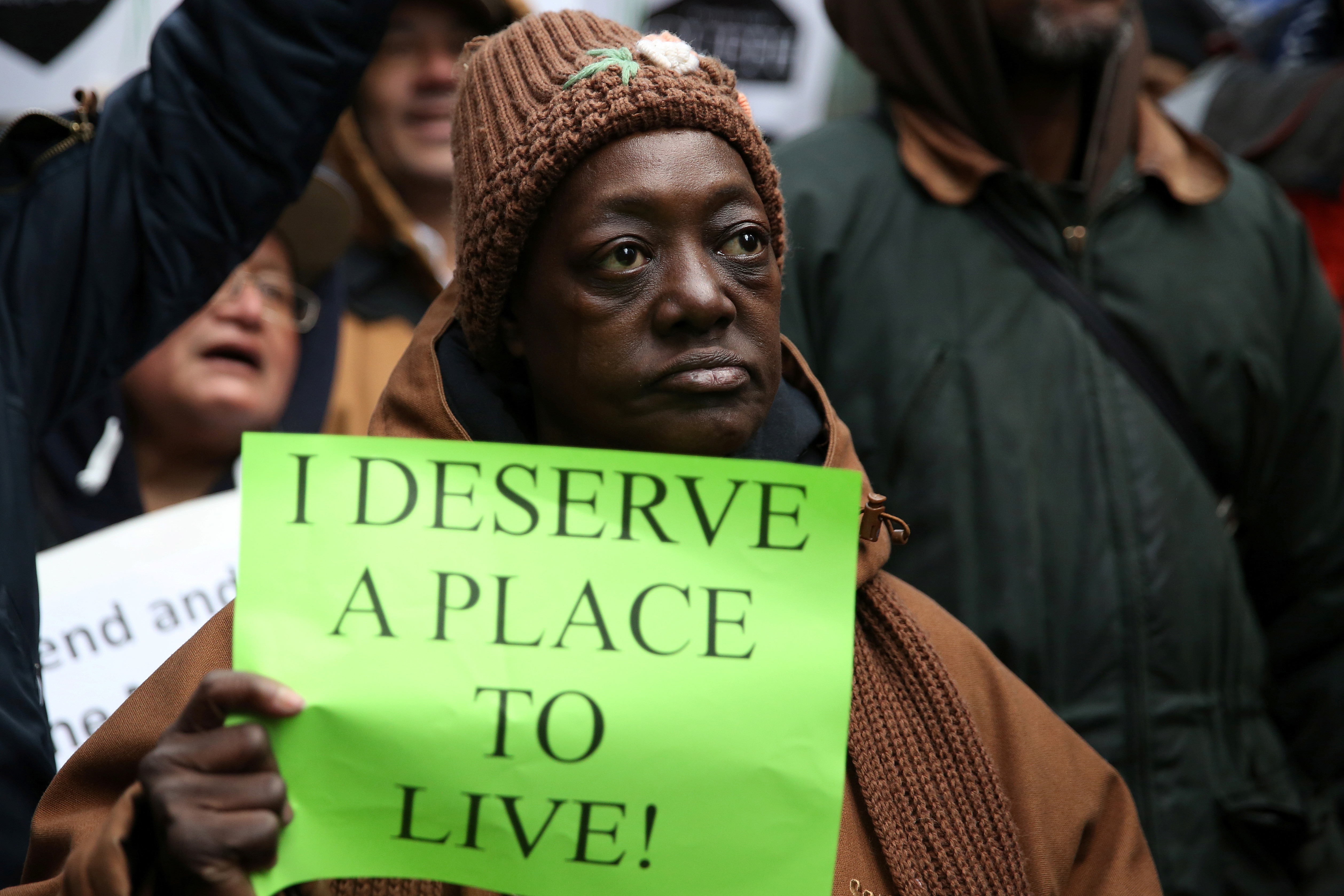 An activist holds a sign while taking part in a protest in support of anti-homelessness outside the office of New York Governor Andrew Cuomo in the Manhattan borough of New York, U.S. March 13, 2017. REUTERS/Ashlee Espinal - RC19F32C0660
