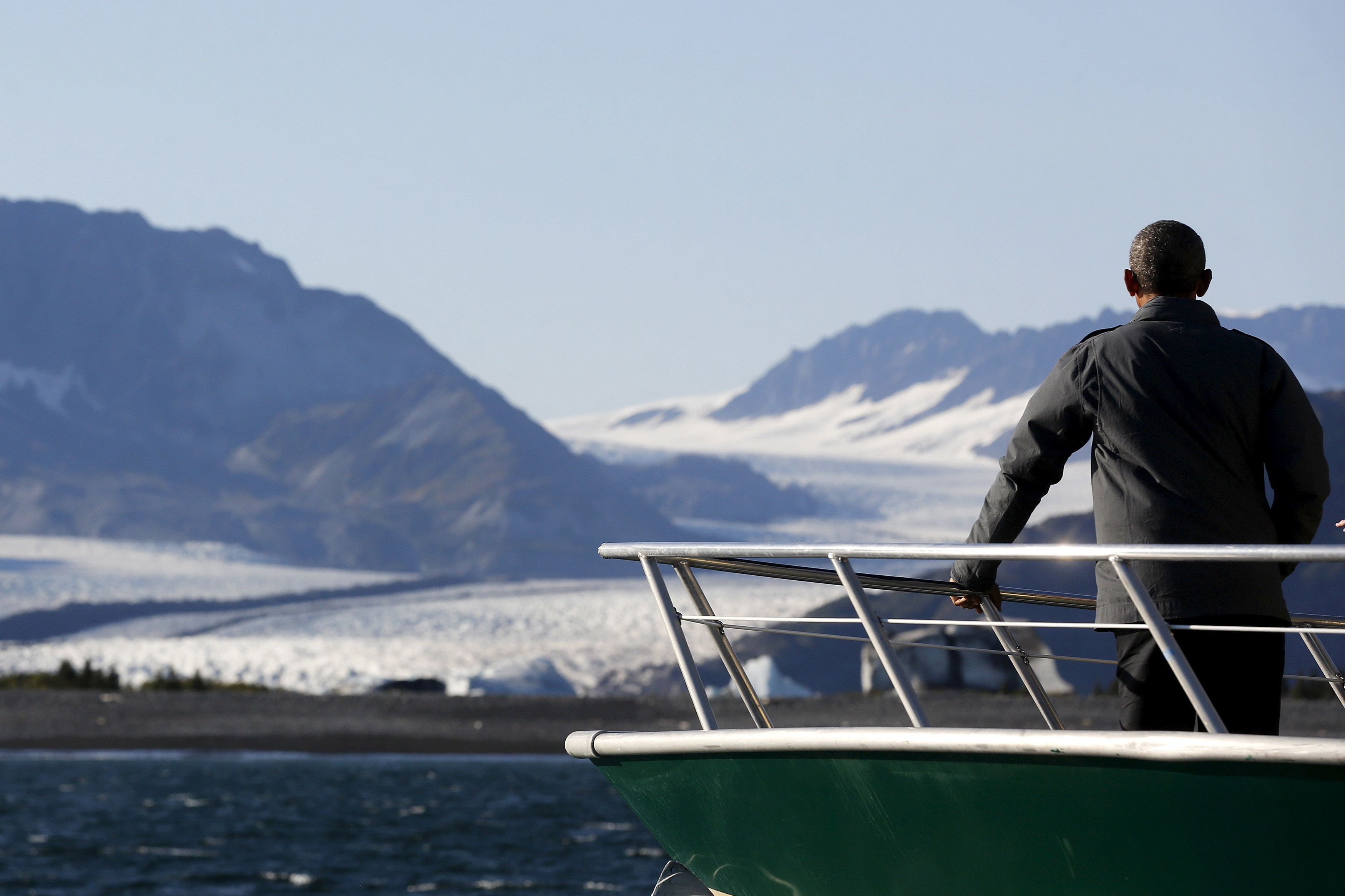 U.S. President Barack Obama views Bear Glacier on a boat tour of Kenai Fjords National Park in Seward, Alaska September 1, 2015. During a three-day visit Obama is also slated to meet people in remote Arctic communities whose way of life is affected by rising ocean levels, creating images designed to build support for regulations to curb carbon emissions. REUTERS/Jonathan Ernst - RTX1QODE