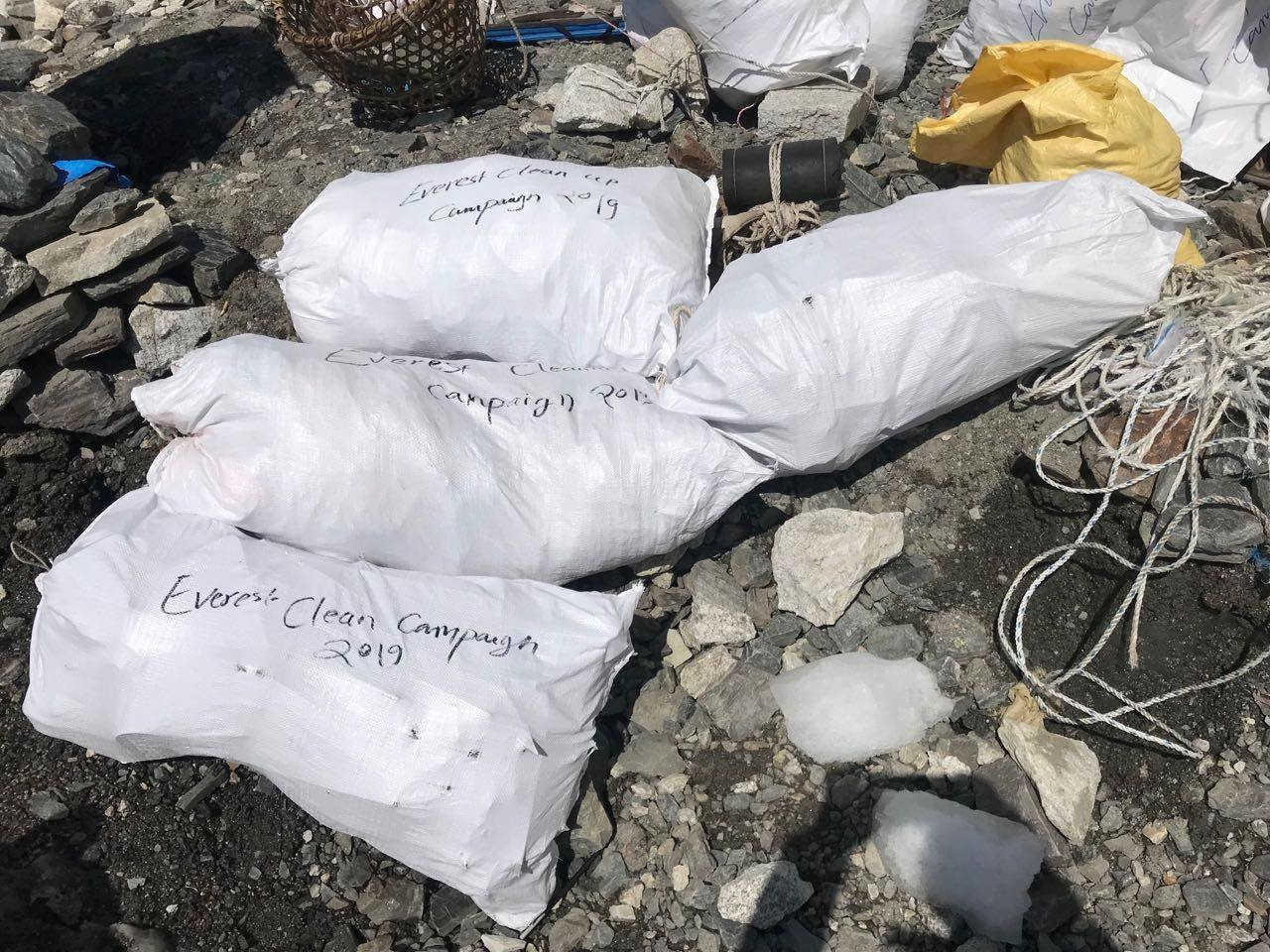 Melting snow revealed thousands of kilogrammes of trash on the world's highest peak.