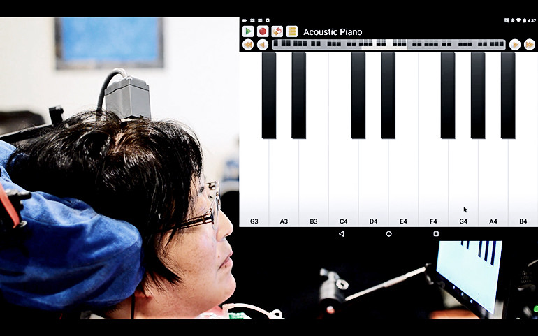 "A participant in the BrainGate clinical trial plays ""Ode to Joy"" on a virtual keyboard interface."
