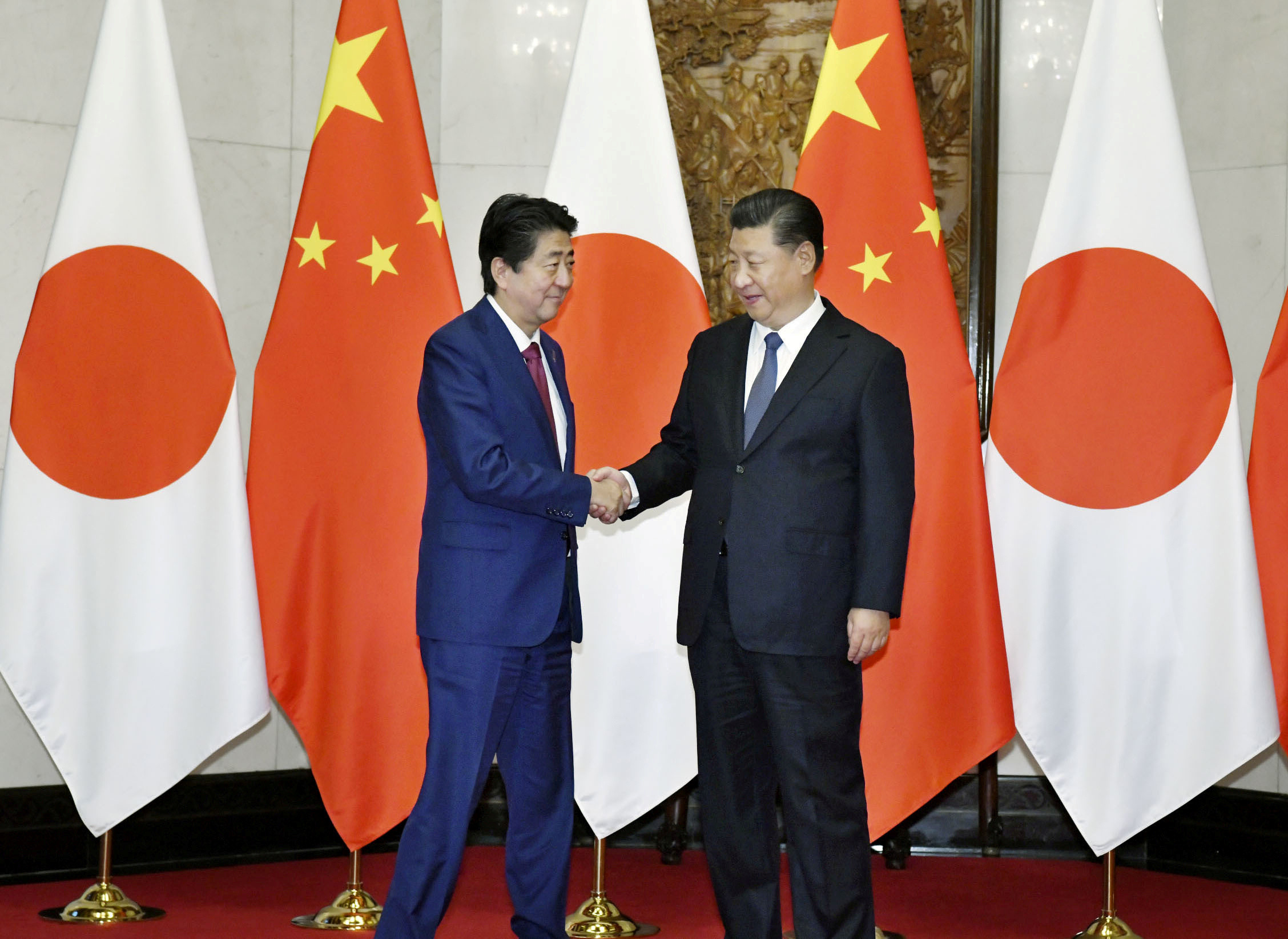 Playing the long game … Japan's prime minister, Shinzō Abe, meets Chinese president Xi Jinping in October 2018.