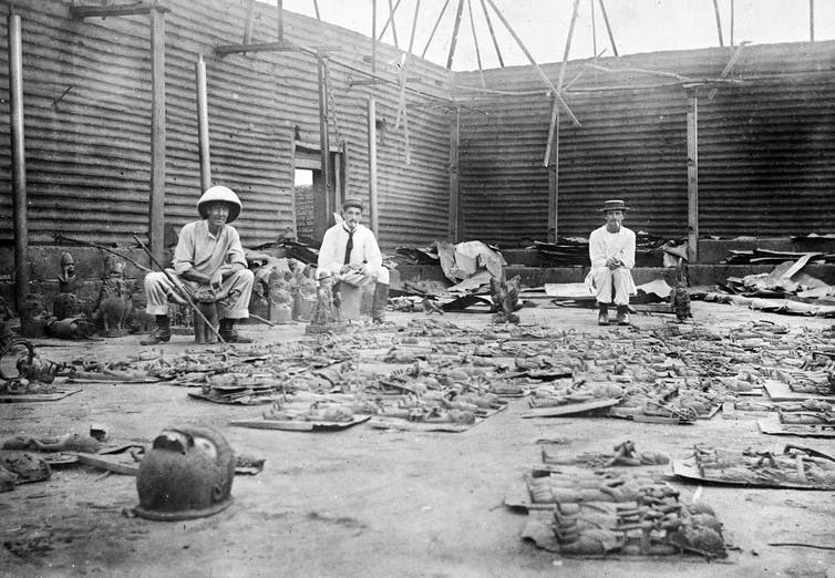 Three British soldiers in the aftermath of the Benin expedition.