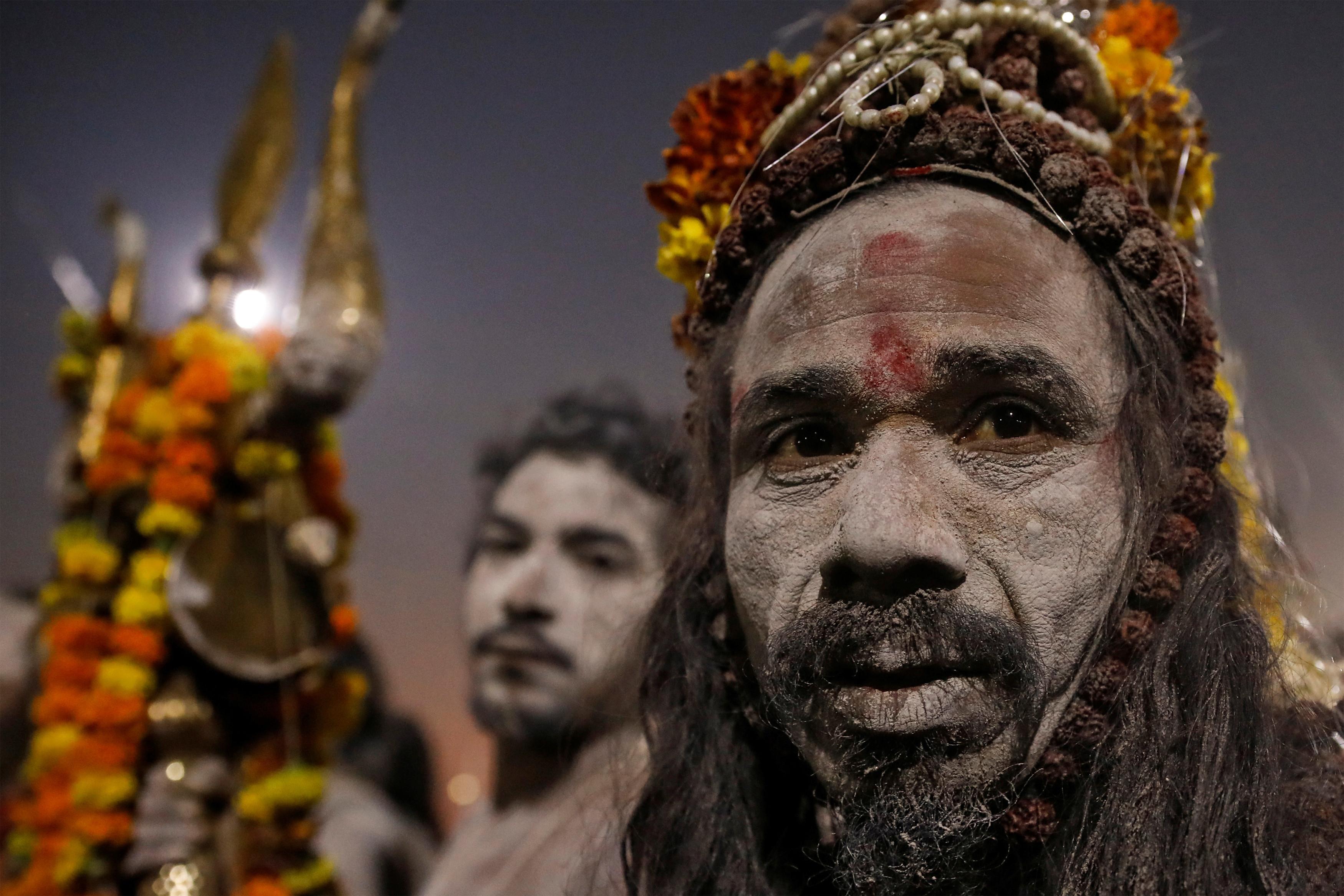 Naga Sadhus or Hindu Holy men leave after taking a dip