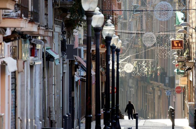 A person walks in a street in Barcelona, Spain, January 1, 2017. REUTERS/Regis Duvignau - RC1C2A72F700
