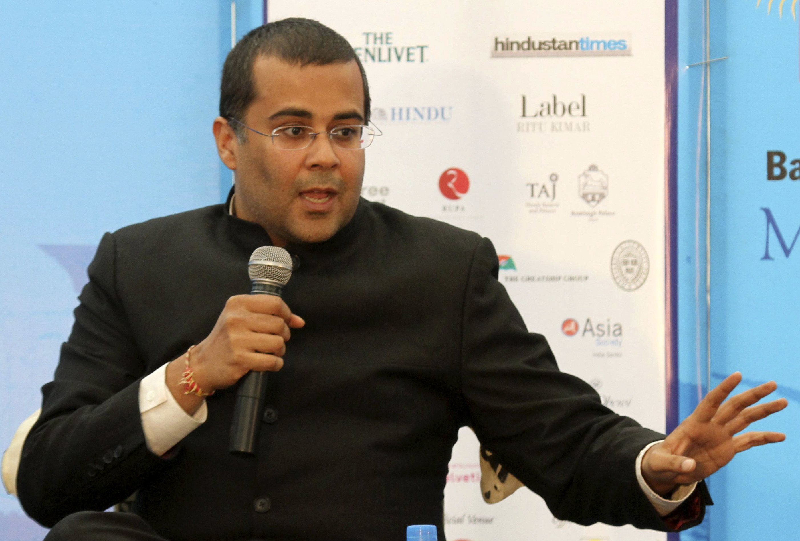Indian writer Chetan Bhagat speaks at the annual Literature Festival in Jaipur, capital of India's desert state of Rajasthan, January 21, 2012. Bhagat on Saturday criticised the support leant to authors whose books are banned for offending religious communities, a day after Salman Rushdie cancelled his trip to Jaipur citing death threat warning.  REUTERS/Altaf Hussain (INDIA - Tags: EDUCATION ANNIVERSARY ENTERTAINMENT) - GM1E81L19VQ01