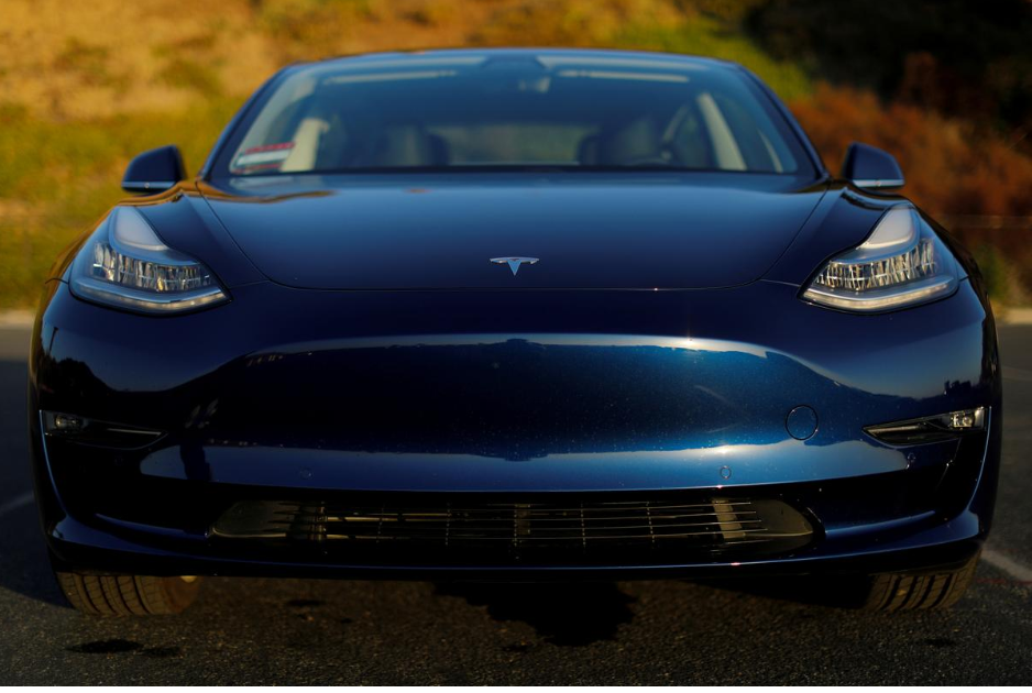 A 2019 Tesla Model 3 electric vehicle is shown in this photo illustration taken in cardiff, California