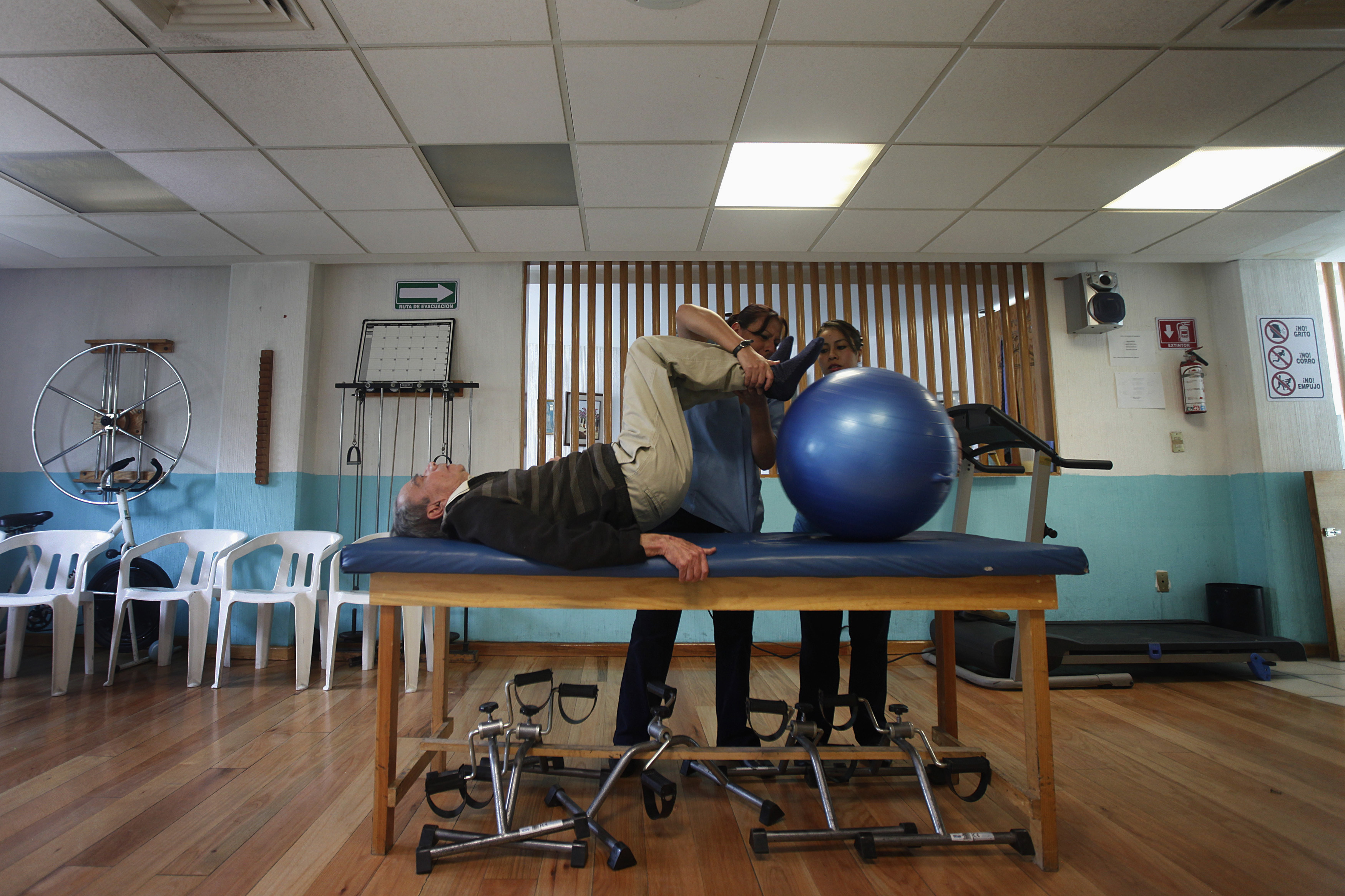 An Alzheimer's patient exercises during a therapy session. Exercising regularly is a lifestyle factor that can influence your risk of dementia.