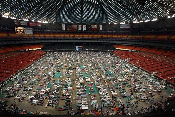 Victims of Hurricane Katrina stay at the Astrodome stadium where 16,000 evacuees are receiving food and shelter in Houston, Texas September 4, 2005. The arena is being used as an intake facility where medical care is provided and evacuees of Hurricane Katrina are evaluated for assignment to other facilities.