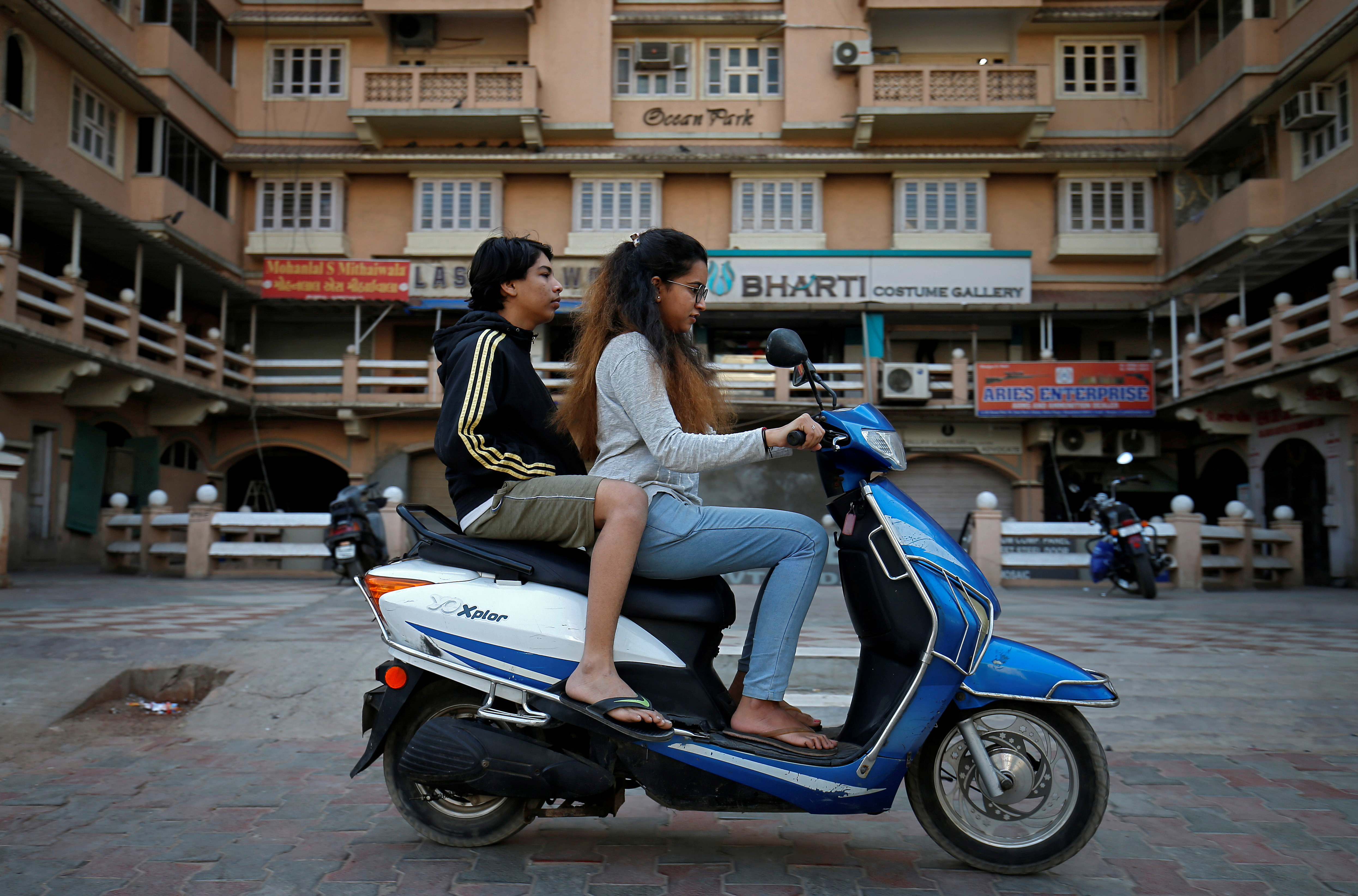 Girls ride an electric scooter in Ahmedabad, India, December 30, 2018. Picture taken December 30, 2018. REUTERS/Amit Dave - RC1DA84A58B0