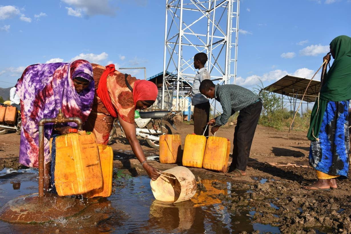 Women gather water in Kinisa, a point where they can access free healthcare in Moyale, Kenya, April 8, 2019.