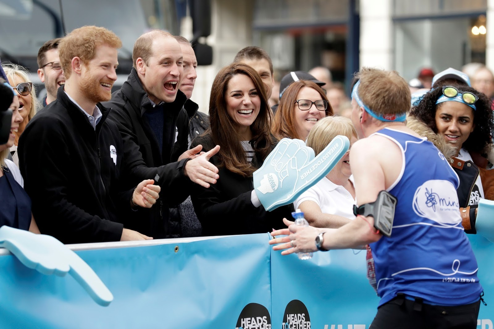 The Duke and Duchess of Cambridge and Prince Harry, the Duke of Sussex, cheer on runners along the route of the 2017 London Marathon