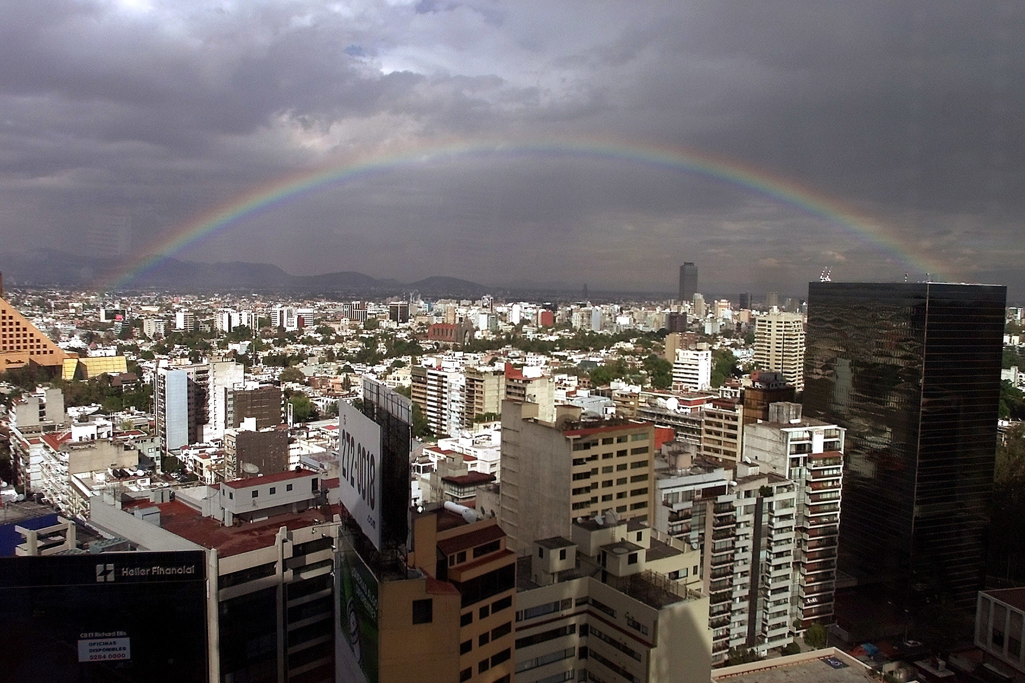 View of Mexico City, crowned by a rainbow, February 13, 2002. One ofthe world's most populated cities, Mexico City got a break from itsnormally high levels of air pollution. REUTERS/Daniel AguilarDA - RTR1HIV