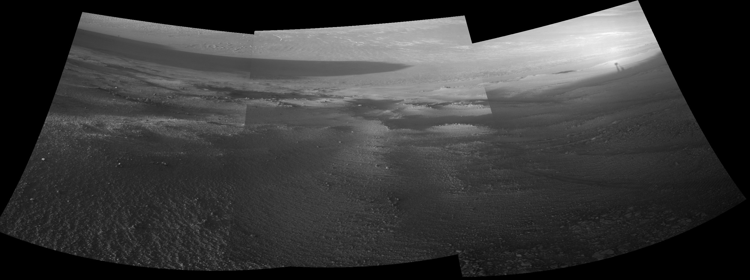 Opportunity's View Downhill Catches Martian Shadows: his mosaic scene combining five images from the navigation camera (Navcam) on NASA's Mars Exploration Rover Opportunity shows a view from inside the upper end of