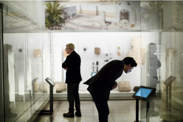 Visitors explore the Penn Museum's Middle East Galleries.