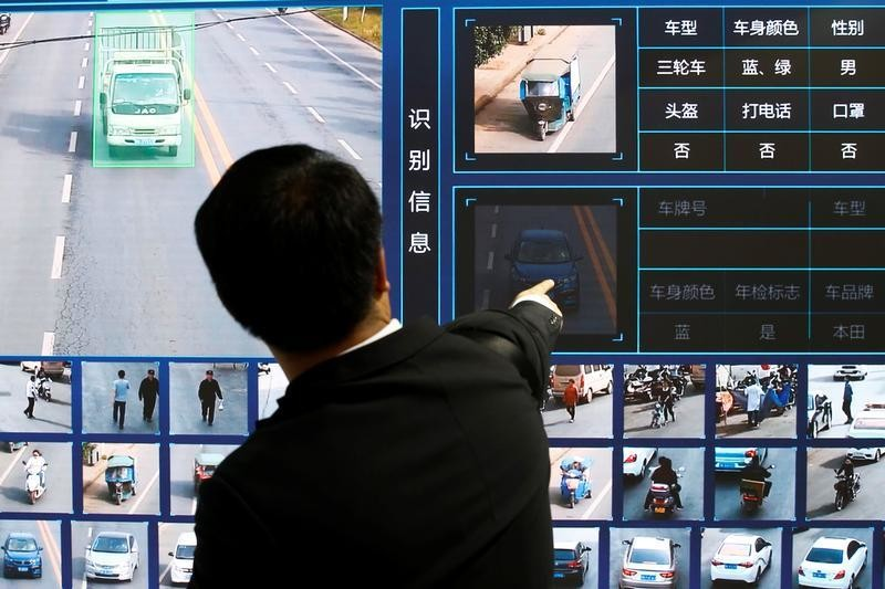 A man points at a screen showing a traffic surveillance software at the stall of the video surveillance products maker Tiandy Technologies at the Security China 2018 exhibition on public safety and security in Beijing, China October 24, 2018.  REUTERS/Thomas Peter - RC1EFE3F8EE0