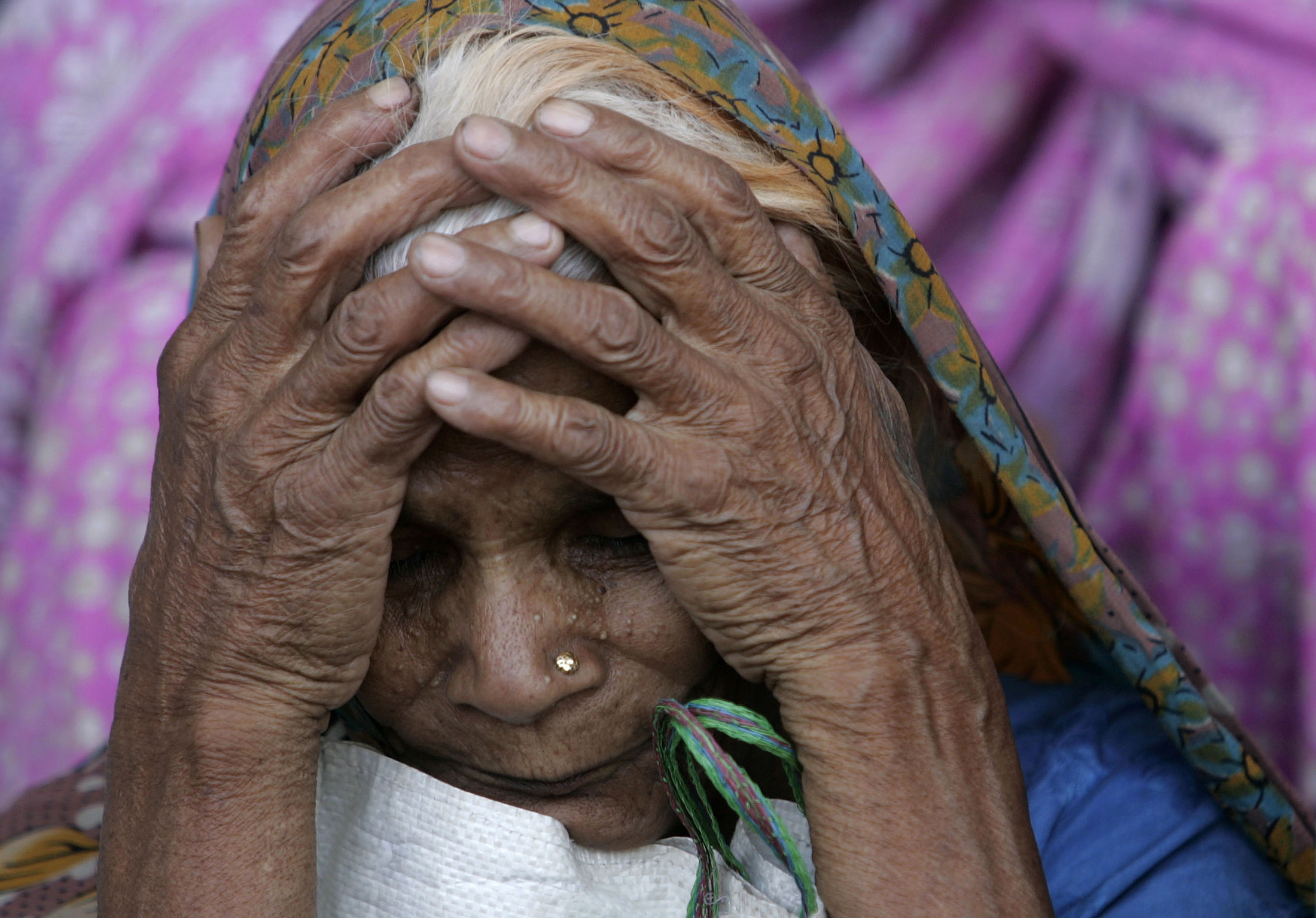 A victim of Bhopal gas tragedy attends a demonstration outside a court in the central Indian city of Bhopal June 7, 2010. An Indian court on Monday sentenced seven people to two years each in prison for negligence in failing to prevent one of the world's worst industrial accidents that killed thousands of people in 1984. REUTERS/Raj Patidar