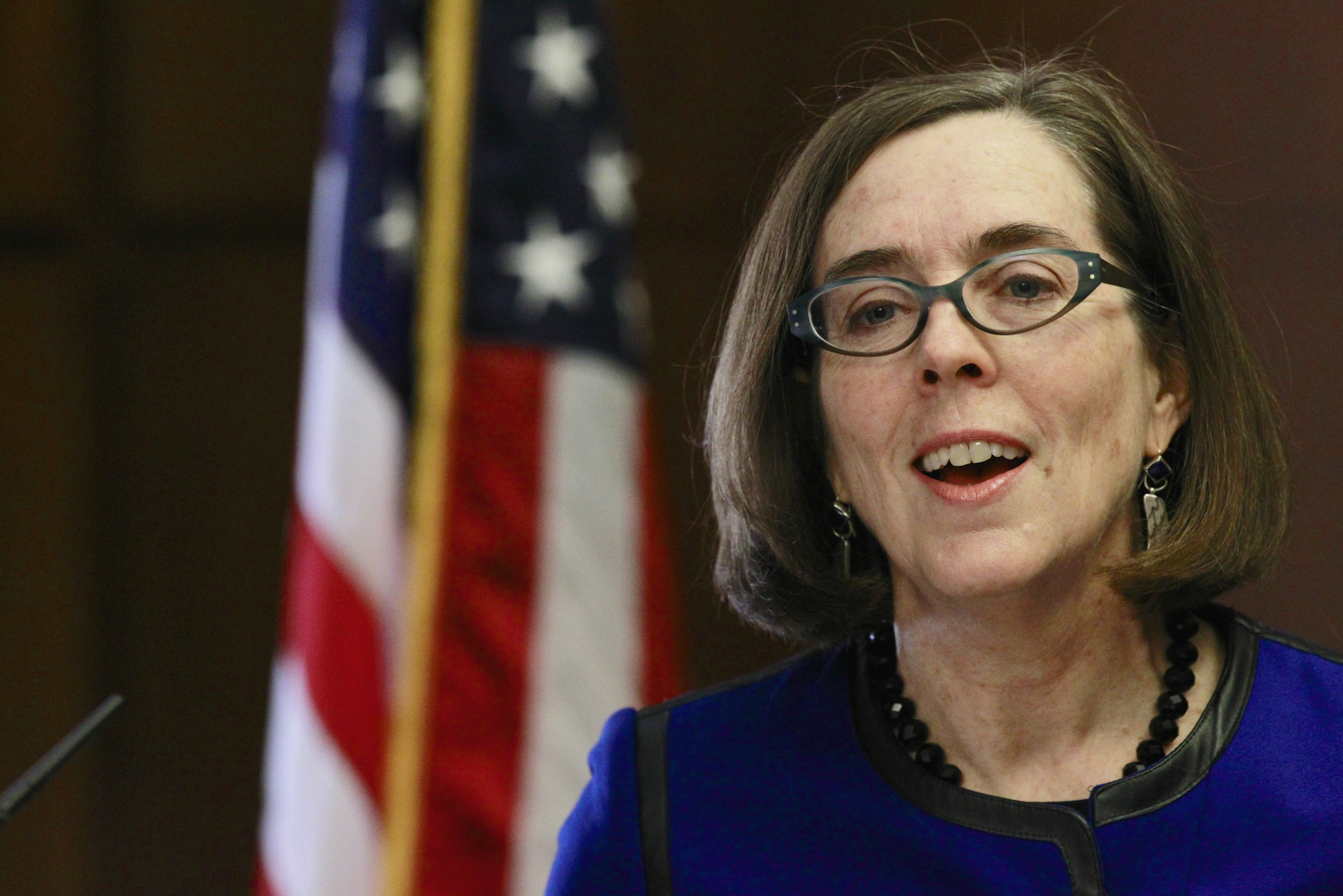 Oregon Governor Kate Brown speaks at the state capital building in Salem, Oregon, February 20, 2015. Brown, a liberal Democrat from Portland, outlined her policy agenda on Friday in her first media event since she took the helm of the Pacific Northwest state to replace John Kitzhaber, whose decades-long political career dissolved in the wake of an influence-peddling scandal involving his fiancee.