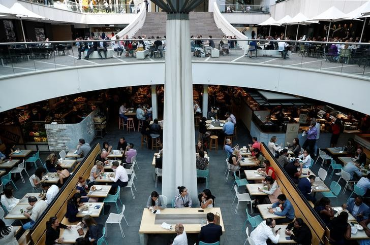 Office workers take their lunch at a food court in Sydney, Australia May 4, 2018. REUTERS/Edgar Su