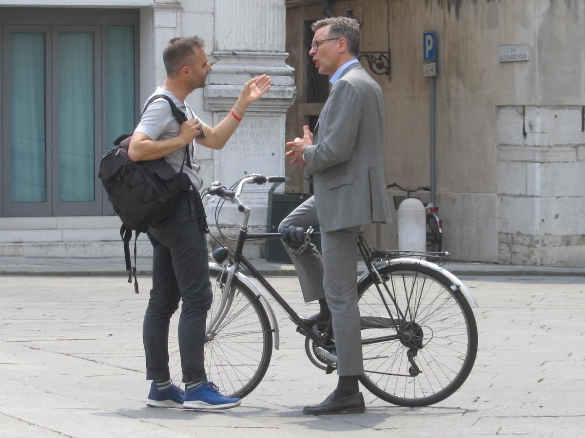 The increase in walking and cycling offers the double benefit of physical activity and social bonding, as seen here in Brescia, Italy.