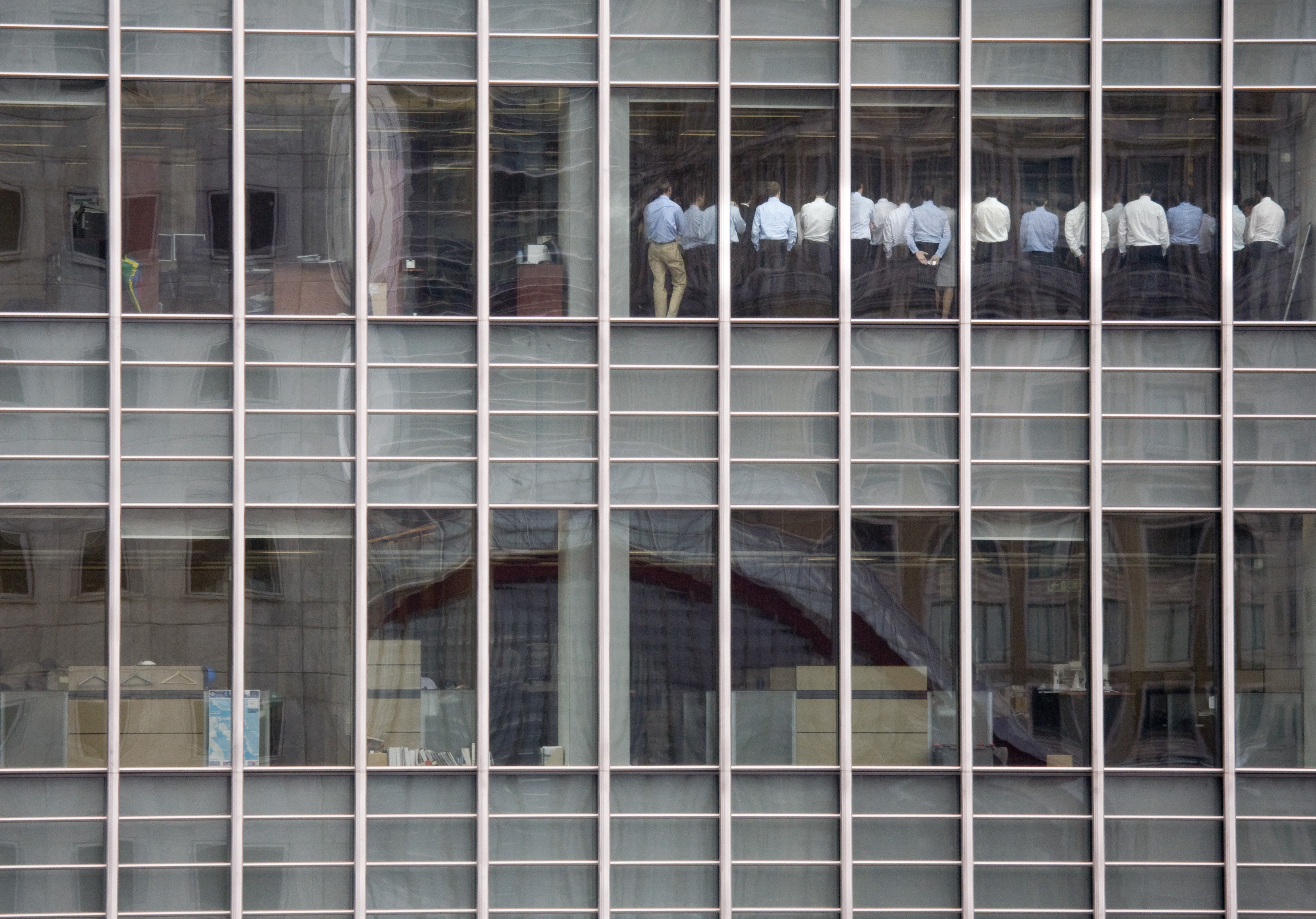 Staff stand in a meeting room at Lehman Brothers offices in the financial district of Canary Wharf in London