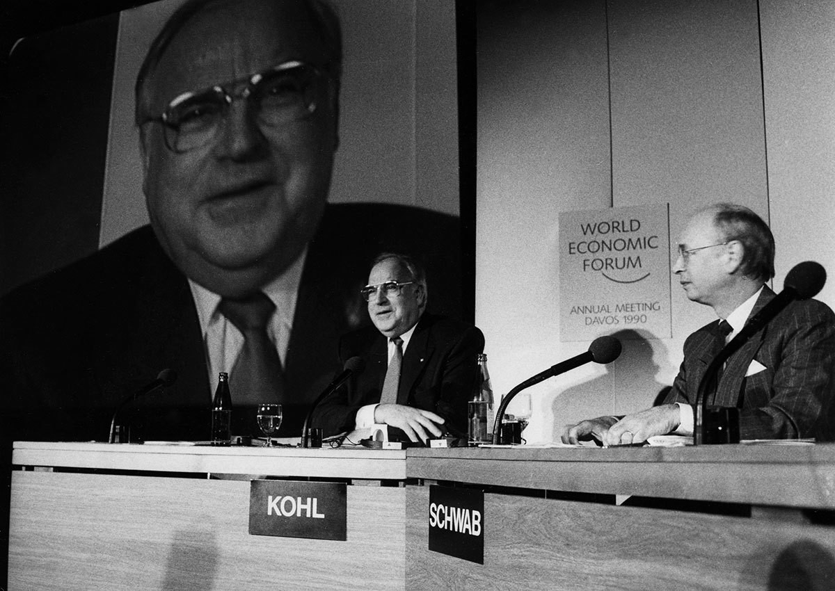 Helmut Kohl, the Chancellor of a reunited Germany, with Klaus Schwab