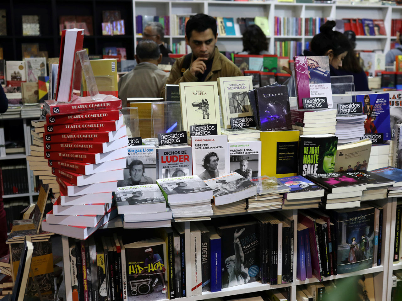 People browse through books during the 23rd Lima International Book Fair in Lima, Peru August 1, 2018. REUTERS/Mariana Bazo