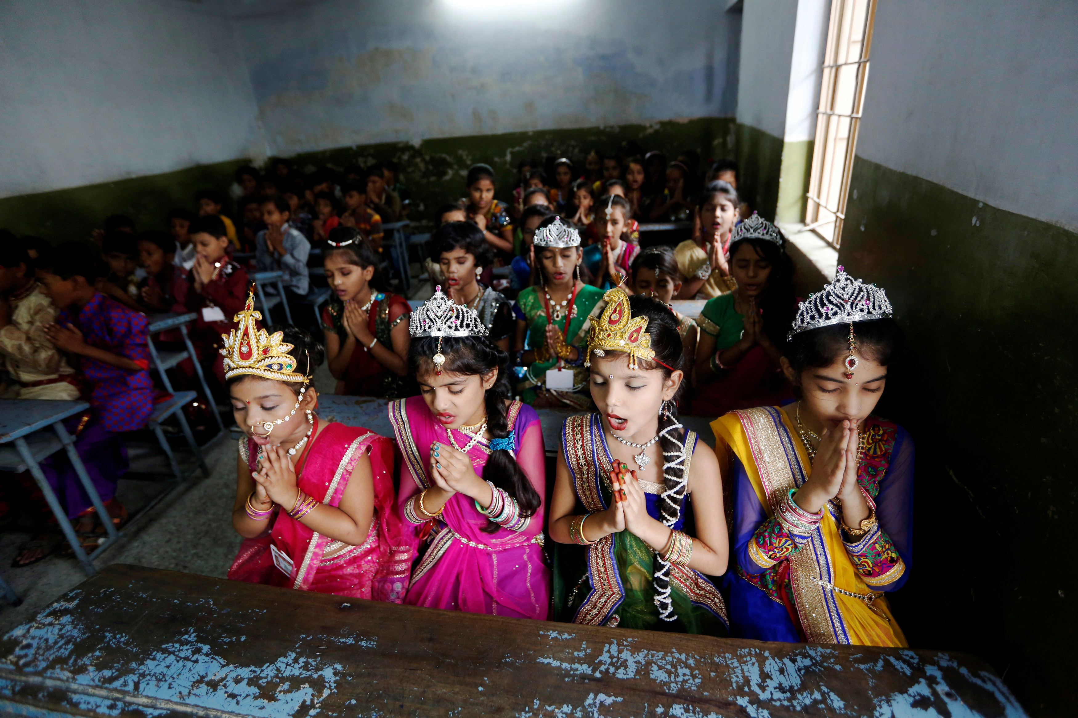 School pupils dressed up as Radha, consort of Krishna, in Ahmedabad, India.