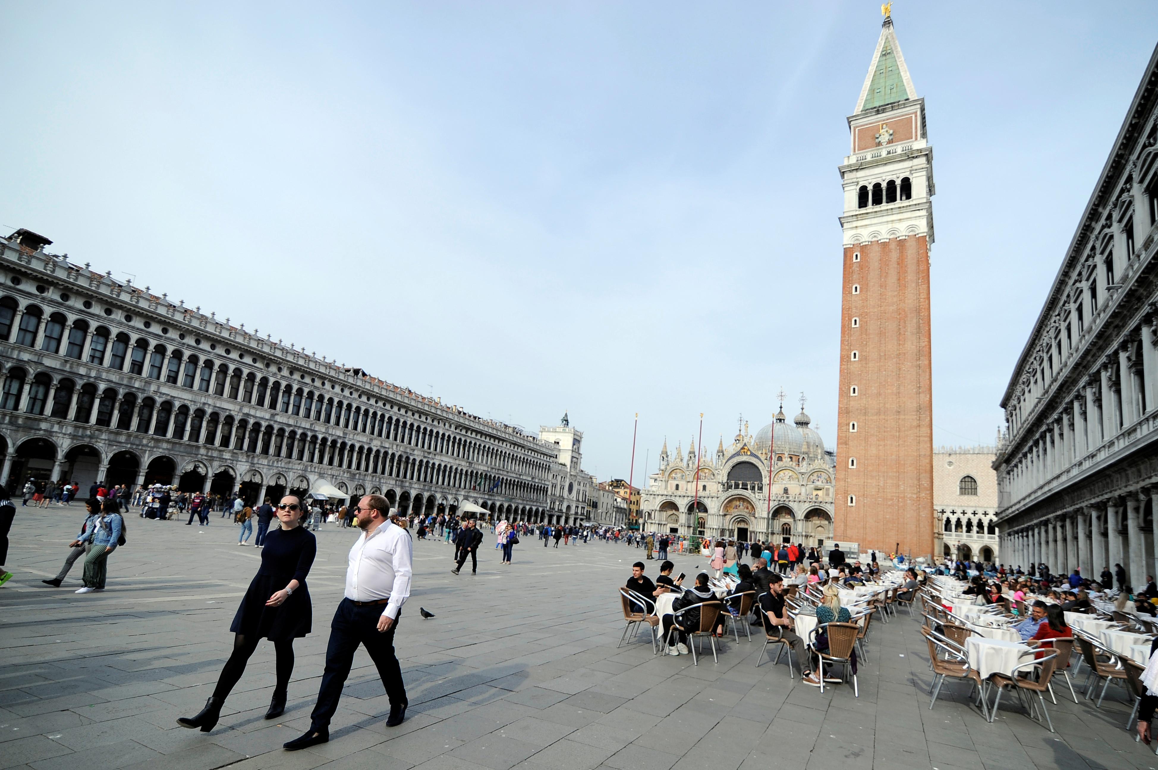 Tourist walk in St.Mark's Square in Venice, Italy, April 2, 2019. REUTERS/Guglielmo Mangiapane