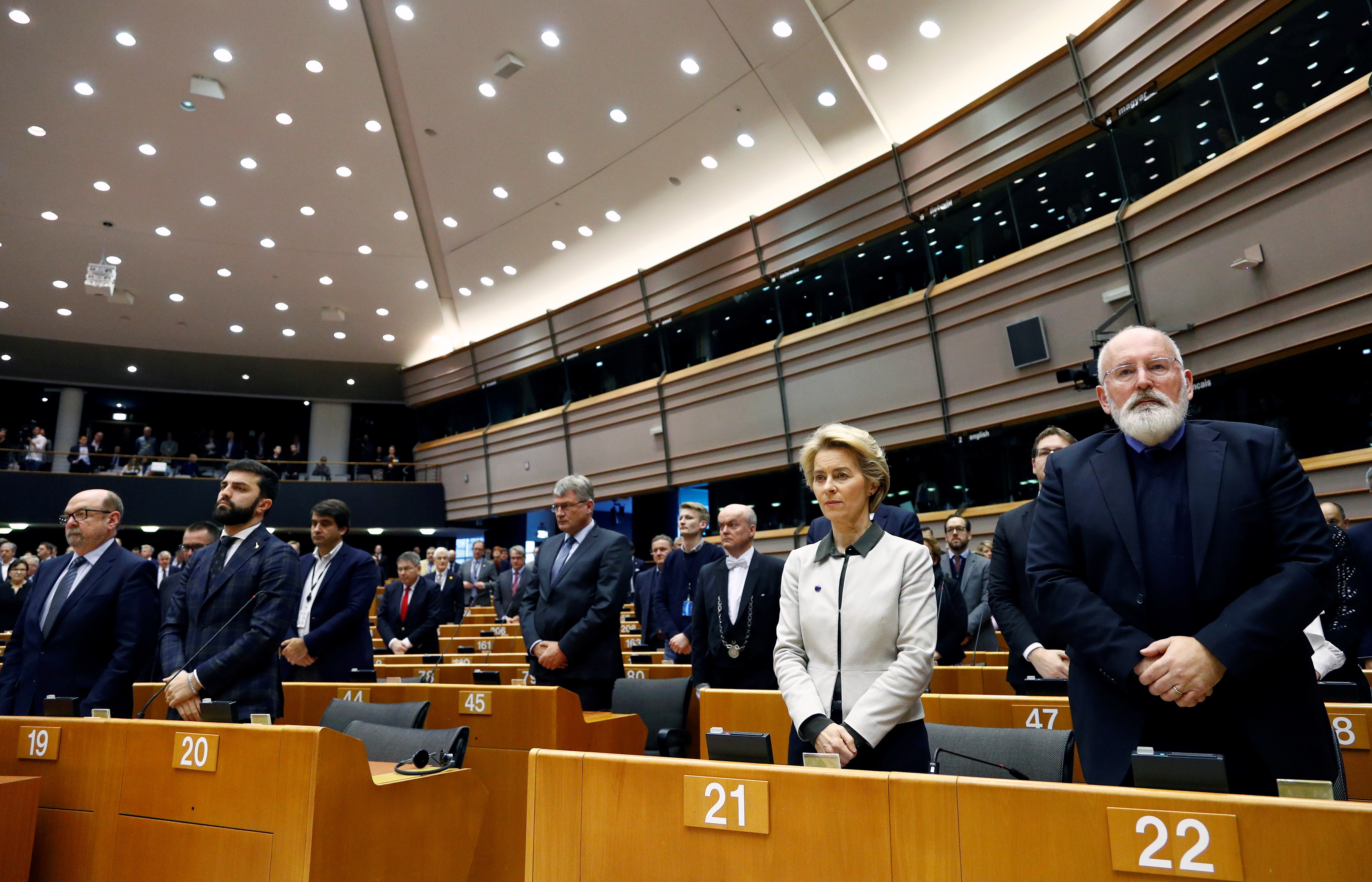 European Commission President Ursula von der Leyen and Vice-President Frans Timmermans observe a minute of silence for the victims of the 2018 Strasbourg attack, at the beginning of an extraordinary session to present a Green Deal plan, at the European Parliament in Brussels, Belgium December 11, 2019. REUTERS/Francois Lenoir - RC21TD97QM8Z